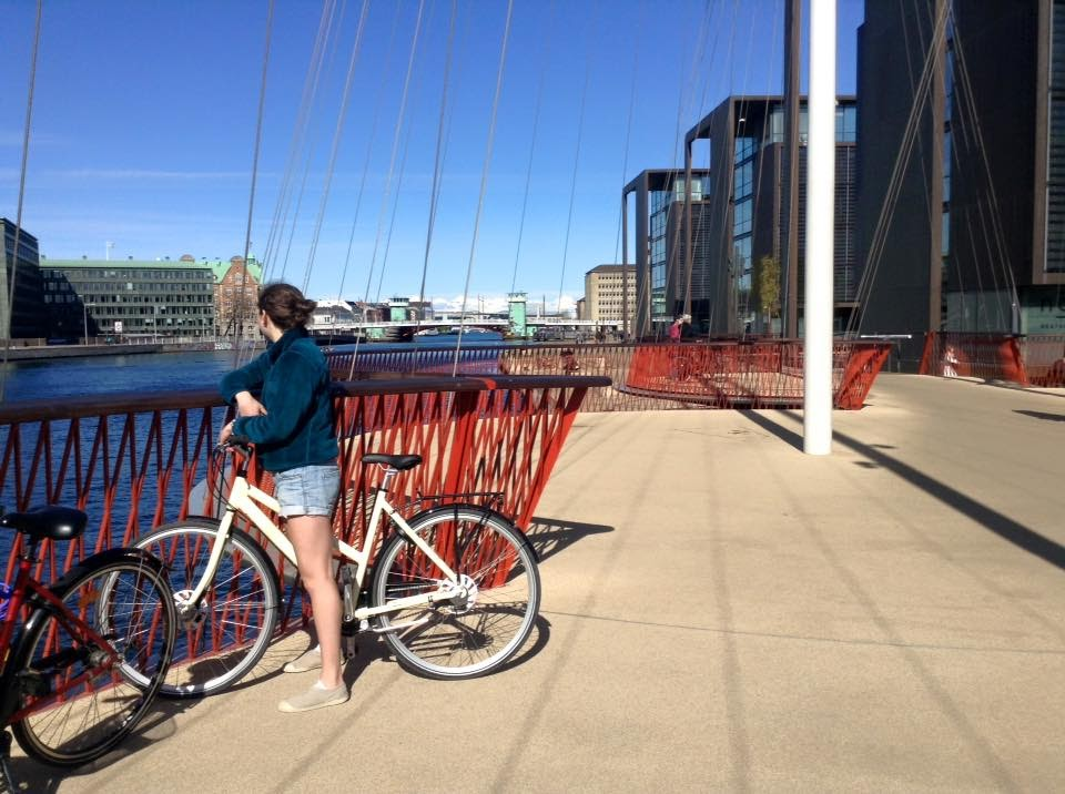 Weiner stands on a bike-only bridge in Copenhagen, Denmark. (Photo by Charlotte Weiner/GroundTruth)