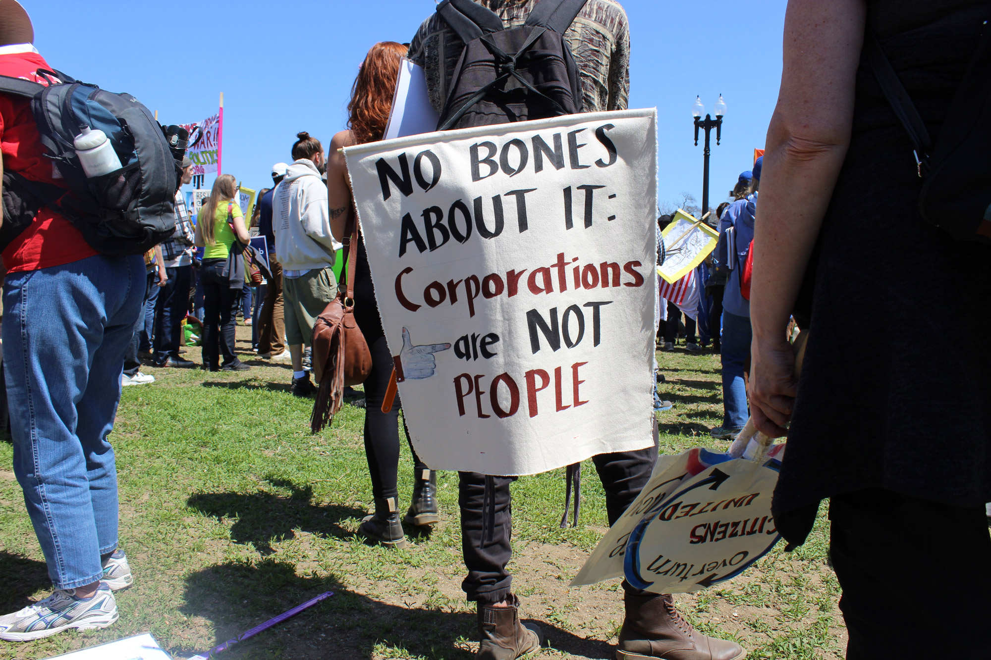 "A protestor holds up a sign that says ""Corporations are not people"" at the three-day Democracy Awakening demonstration in Washington, D.C. (Photo by Carson McGrath/GroundTruth)"
