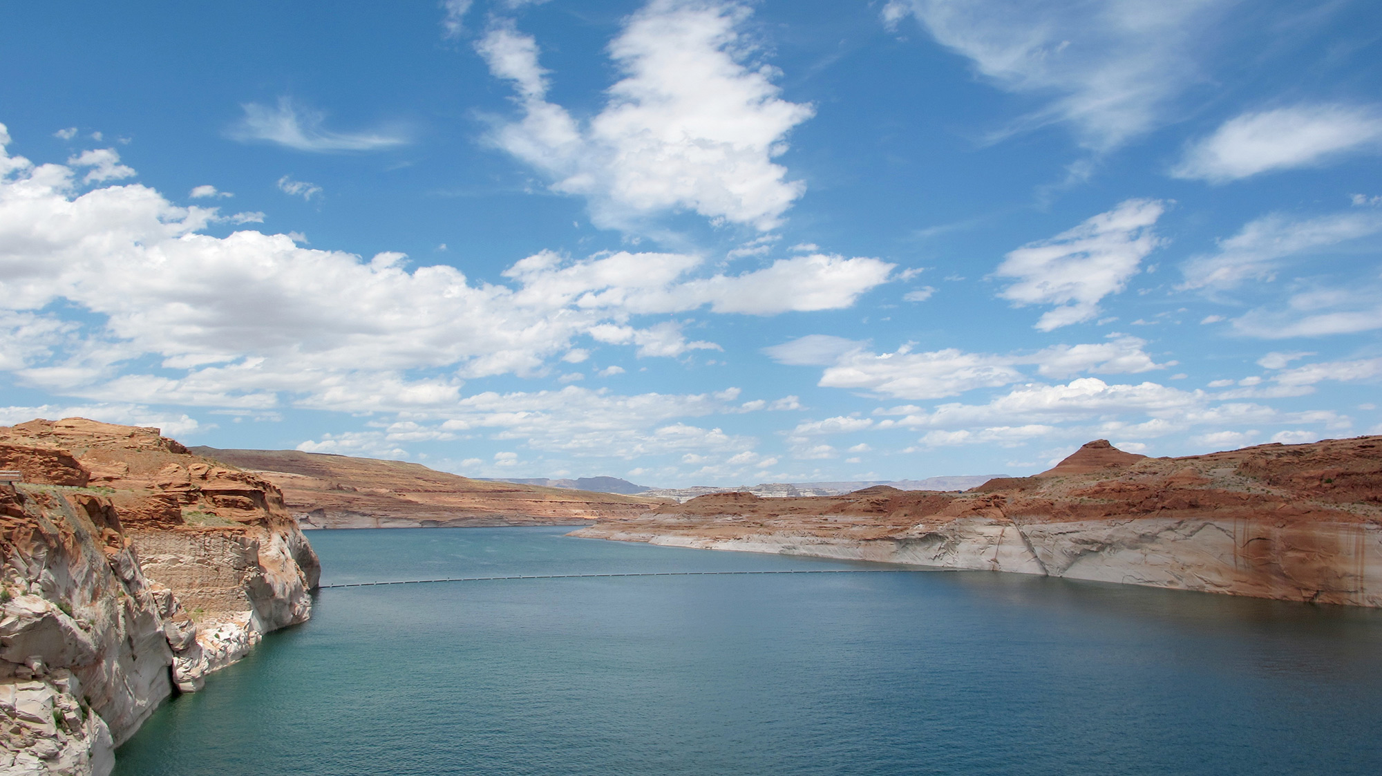 """A nearly 100-foot high white-bleached """"bathtub ring"""" marks where the water once rose at Lake Powell. (Photo by Charlotte Weiner/GroundTruth)"""