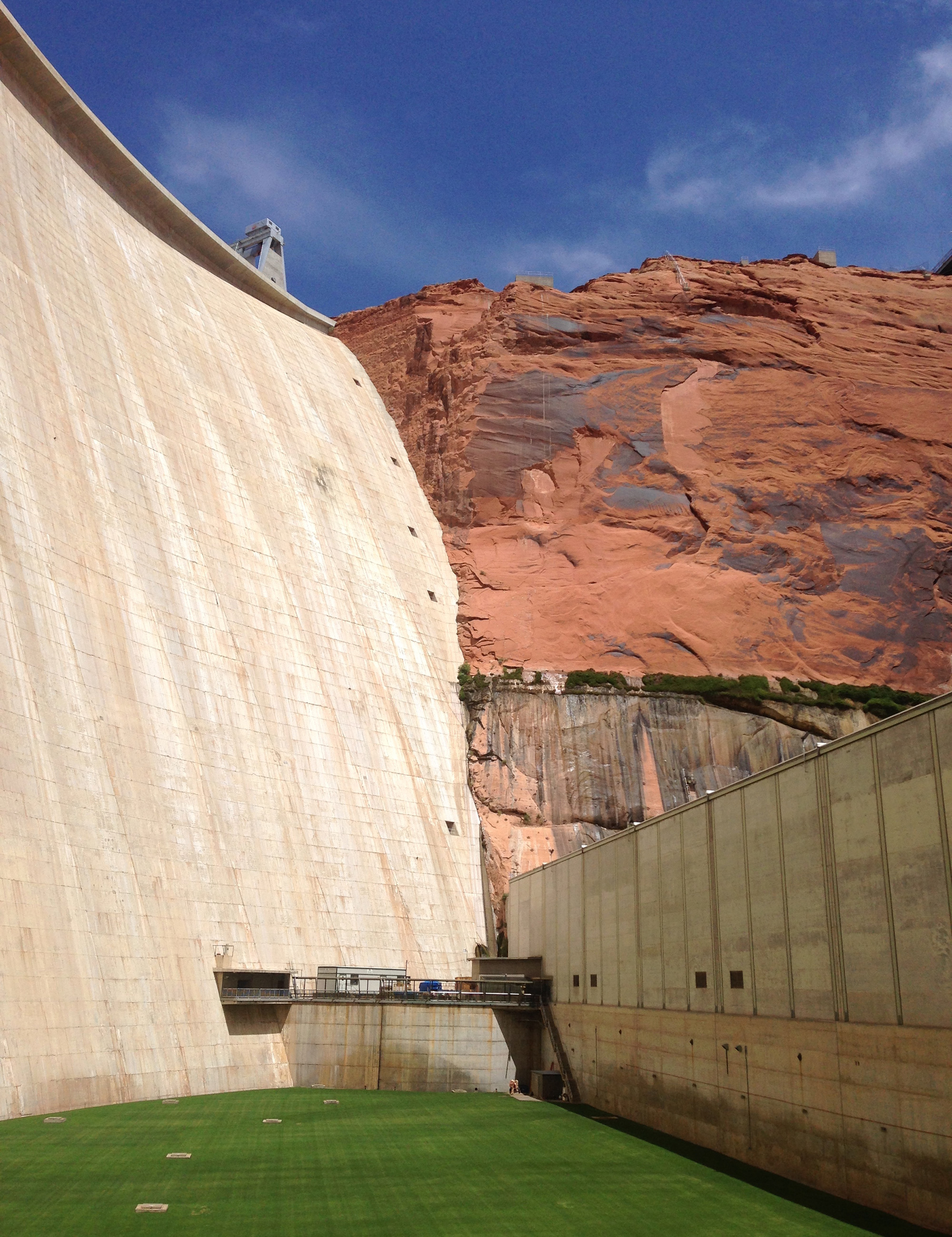 Behind the 710-foot wall of concrete seen in a view of Glen Canyon Dam, Lake Powell is the second-largest reservoir in America. (Photo by Charlotte Weiner/GroundTruth)