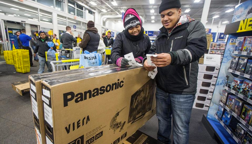 Melvin and Markesha Hernandez bought Panasonic televisions on Black Friday in 2014, then then flipped for a profit. It's one creative way that they've managed to keep their family afloat in hard times. (Photo by Aram Boghosian/Boston Globe)