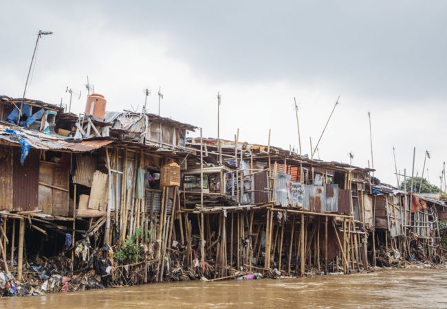 """Many neighborhoods along Jakarta's rivers are being bulldozed to make way for river widening and """"revitalization"""" projects. (Photo by Muhammad Fadli/GroundTruth)"""