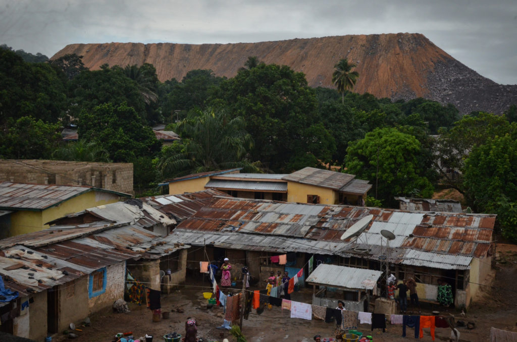 In eastern Sierra Leone, gravel caused by mine blasts can be seen surrounding Koidu, a city known largely as the capital of the diamond mining industry. (Photo by Cooper Inveen/ICIJ)