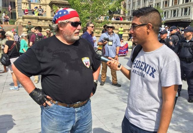Mohamed Abdelfattah interviews Jack, a Trump supporter who rode from North Dakota to Cleveland for the RNC. (Photo by Jenny Montasir/GroundTruth)