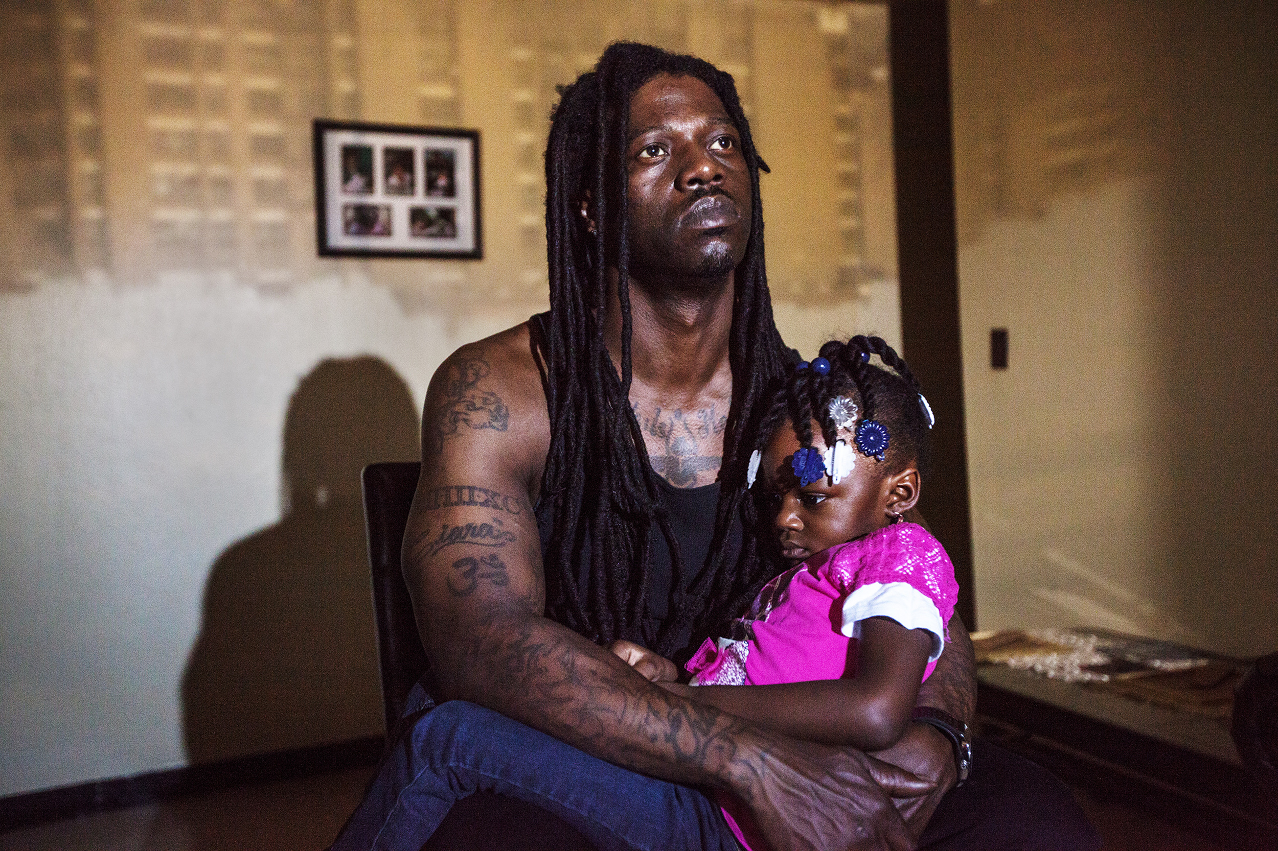 "Raheem Grant, 39, poses for a portrait with his daughter, Nature Grant. ""When I was growing up I didn't have a father. My little one, she gets scared of the dark: 'You don't have to be scared because Daddy is here.' Just knowing that I am there for them makes me feel like I accomplished a lot."""