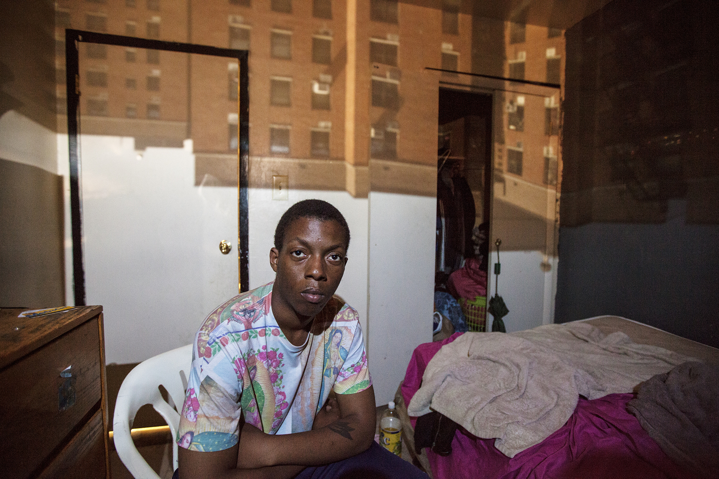 "Esau ""Chubbs"" Johnson, 23, poses for a portrait in East New York, NY on May 30, 2015. ""The cops are cracking down on us. You know, they are shooting kids. That's really what I am worried about: my daughter growing up in that environment."""