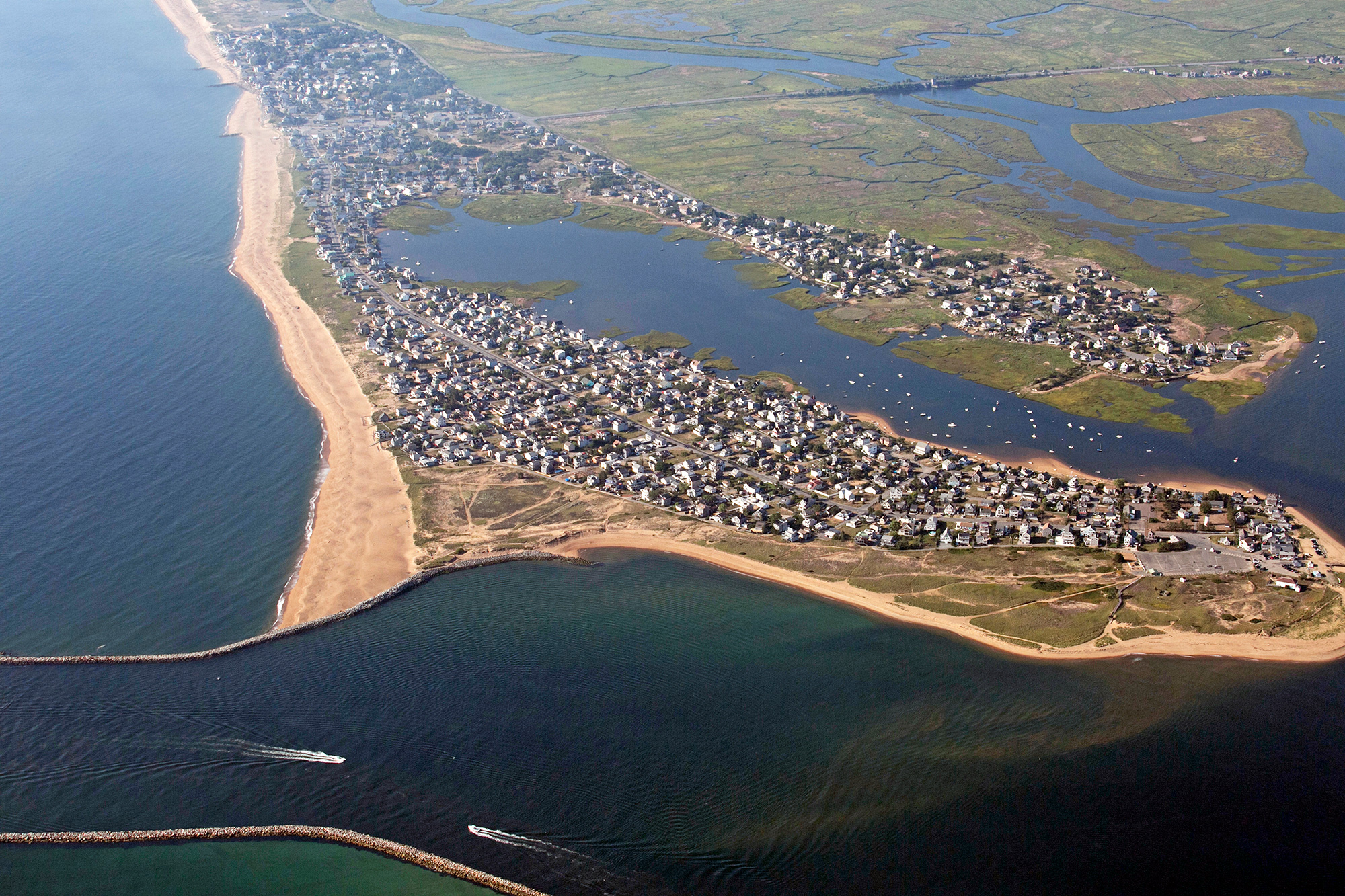 """Across New England, coastal waters are rising due to climate change. Plum Island, on the North Shore of Massachusetts, is particularly vulnerable to major flooding from storm surges and beach erosion. """"Don't build here if you're afraid of losing your house,"""" says longtime resident Verne Fisher. (Photo by Lauren Owens Lambert/GroundTruth)"""