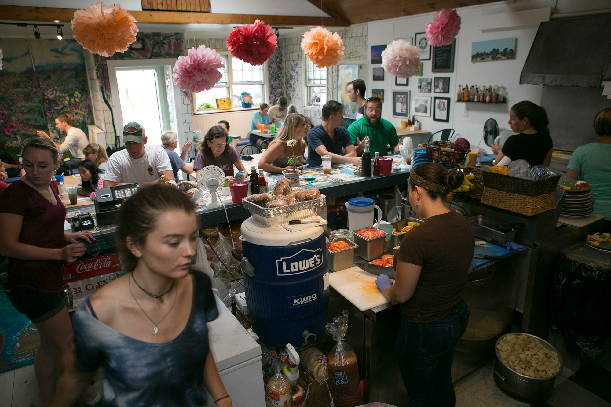 The breakfast rush at Mad Martha's Cafe on Plum Island. The restaurant is one of several local businesses built on a fragile ecosystem of sands that are constantly shifting. It is at risk of flooding and damage from rising sea levels and intensifying storm surges. (Photo by Lauren Owens Lambert/GroundTruth)