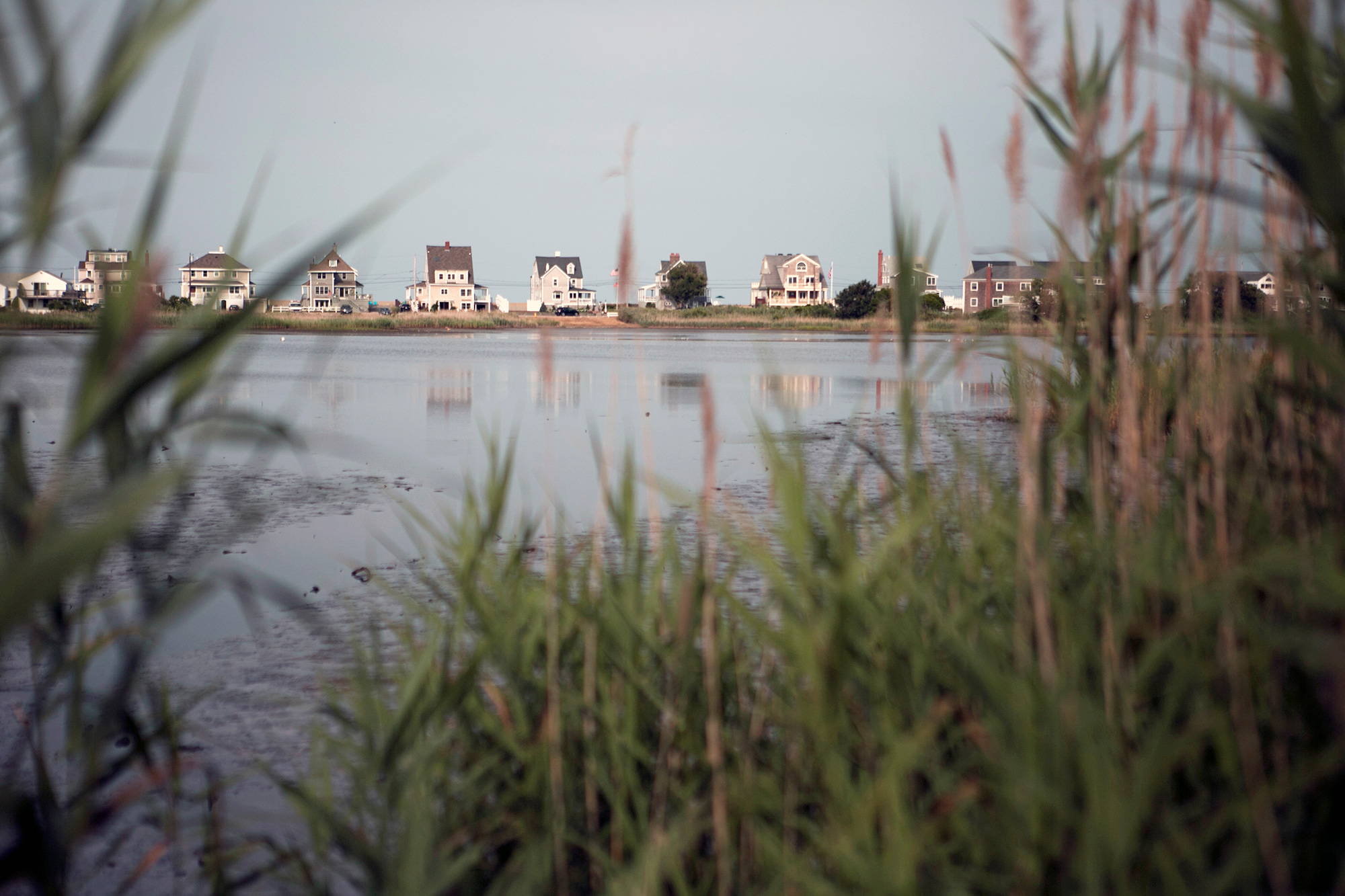 Scituate homes are being raised 16 to 20 feet above sea level to comply with the '100-year-storm flood marker,' a level that fluctuates depending on location. The town offers select grants to homeowners to adapt their homes for flooding through the Federal Hazard Mitigation Grant Program. Financial assistance can provide up to 75 percent of the total cost of the climate mitigation project. (Photo by Lauren Owens Lambert/GroundTruth)