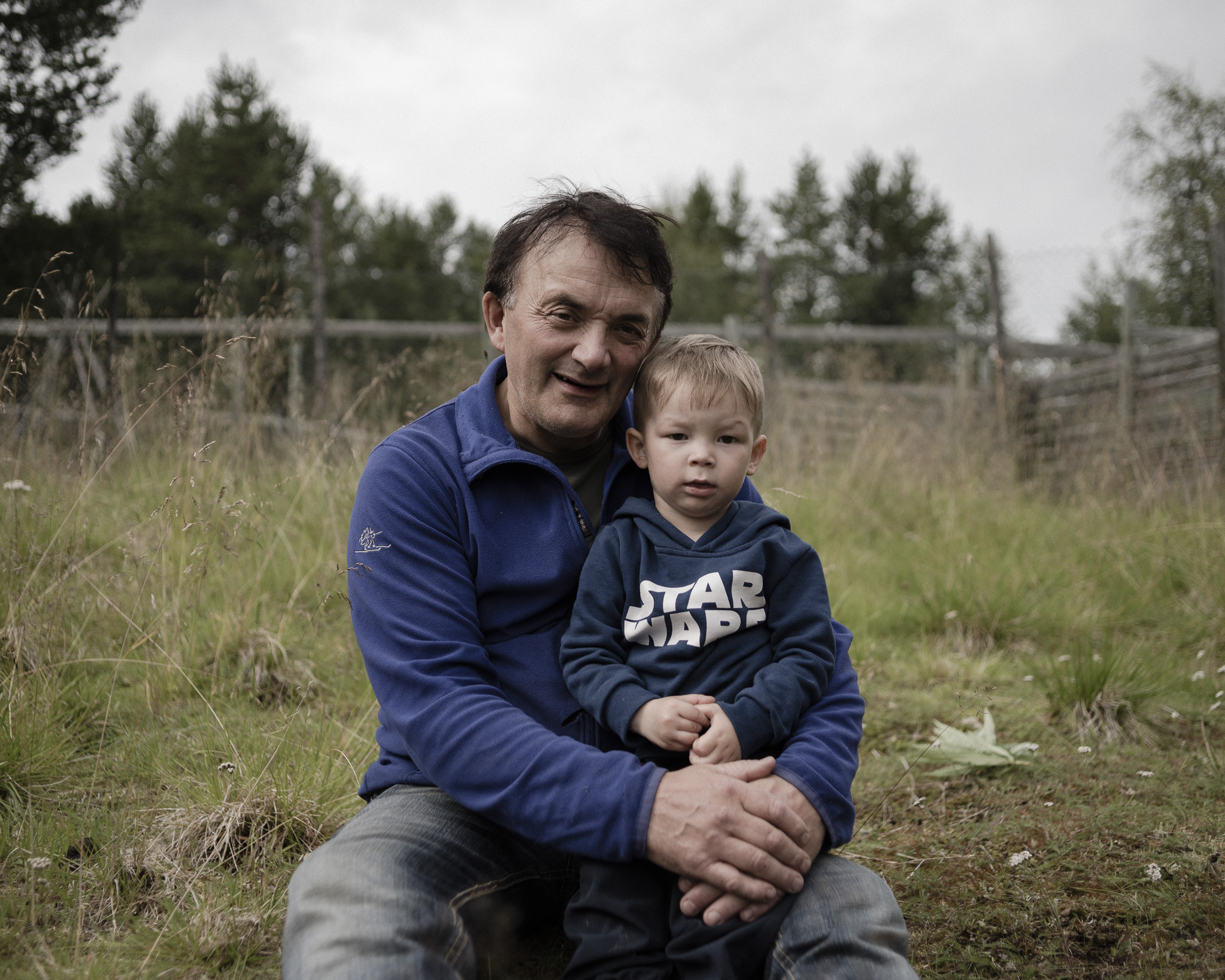 Arvid and his grandson outside of their home in Karasjok, northern Norway. (Camilla Andersen/GroundTruth)