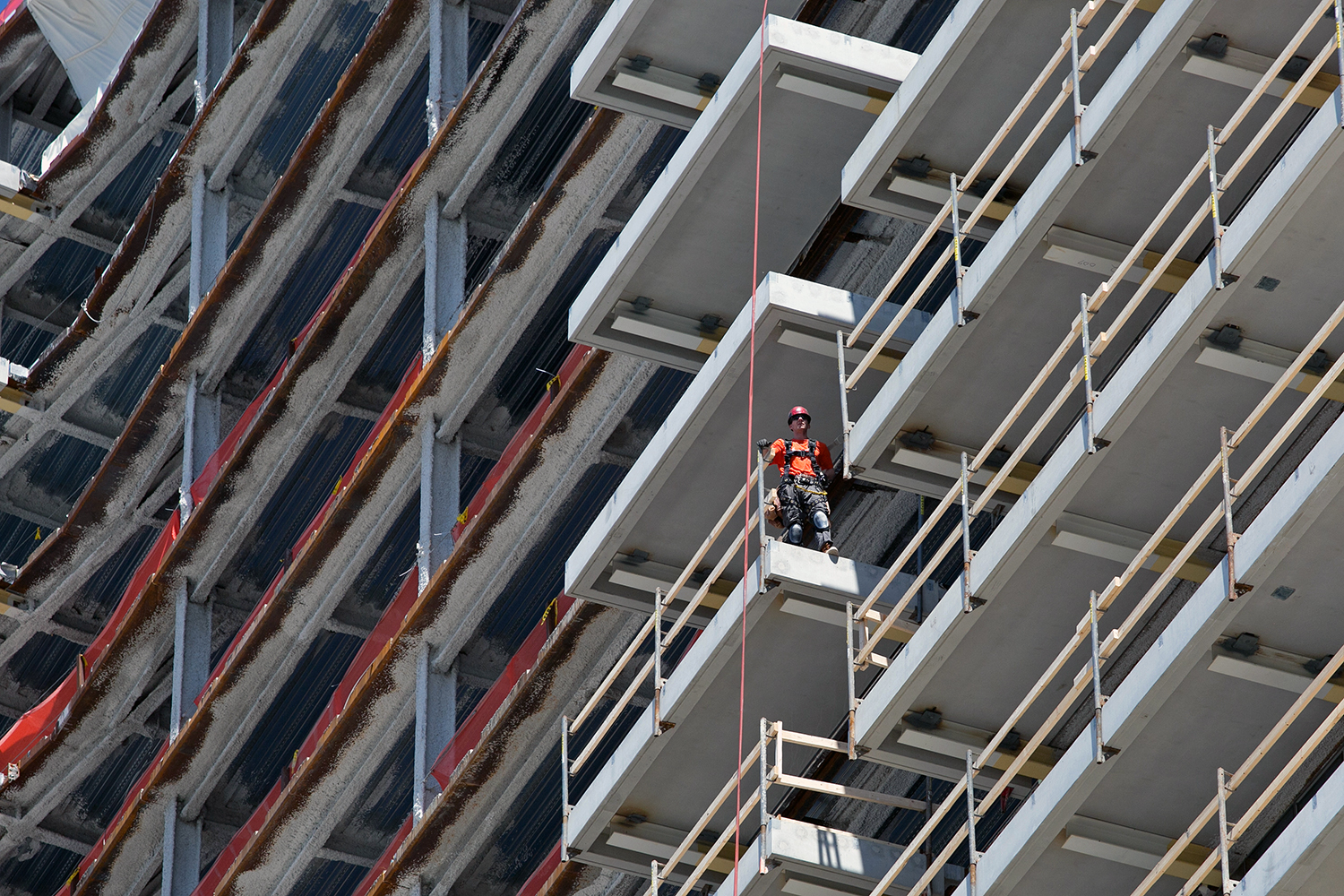 Construction workers are pictured at a development on the South Boston waterfront, June 6, 2016. (Photo by Lauren Owens Lambert/GroundTruth)