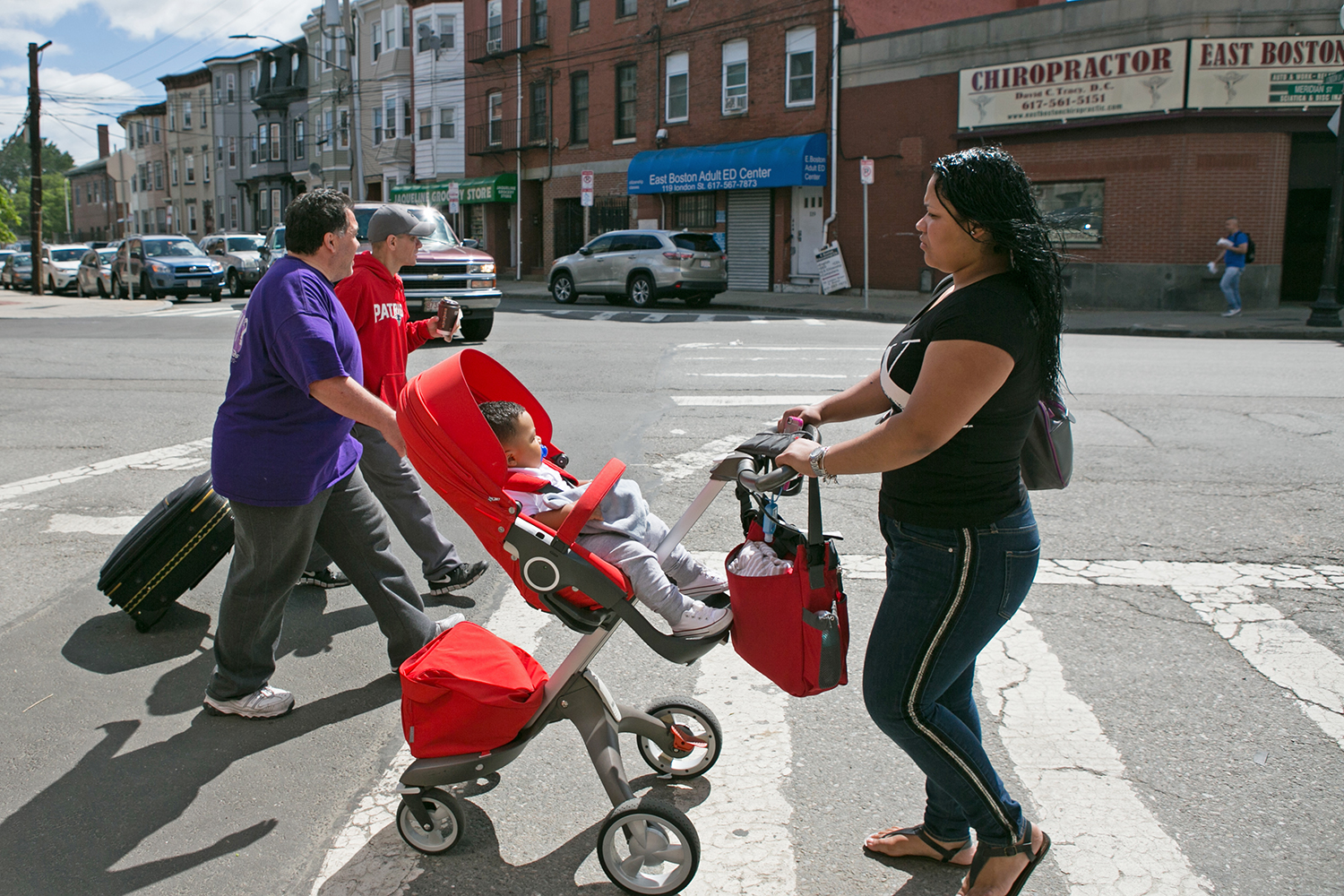 Pedestrians walk in East Boston on June 9, 2016. (Photo by Lauren Owens Lambert/GroundTruth)