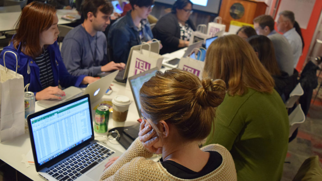 Graduate students from Northeastern University analyzing crime data from the City of Boston as they try to piece together a possible story. (Frank Dutan/GroundTruth)
