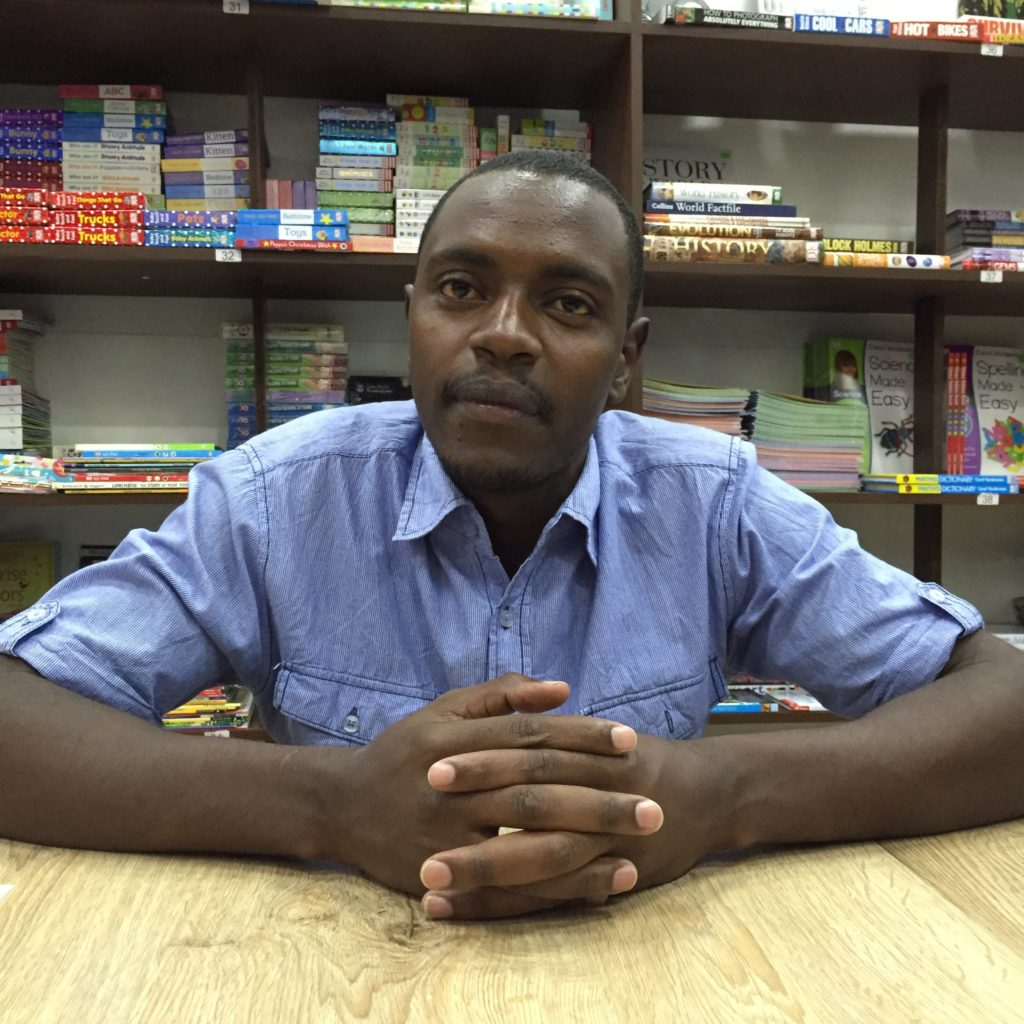 Samuel Mwangi hid with others inside of Savani's bookstore on the day of the Westgate shooting in 2013, a terrorist attack that killed 67 people. (Photo by Kevin Grant/GroundTruth)