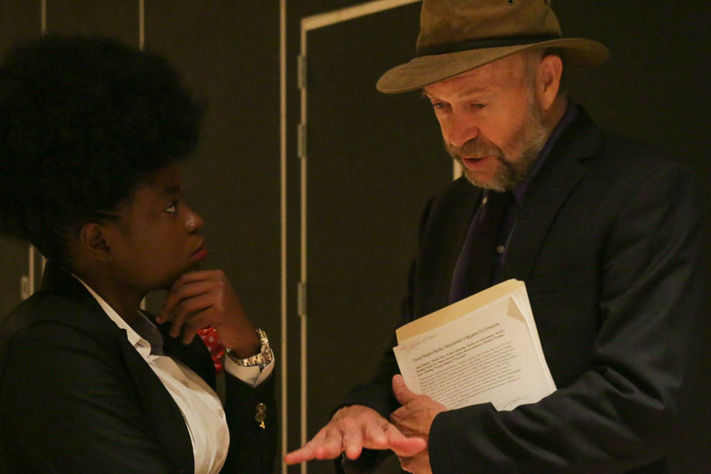 Adenine Akinsemolu, an assistant professor at Obafemi Awolowo University talks with climatologist and Columbia professor James Hansen. The two professors have both taken steps to support youth combating climate change. (Photo by Justine Calma/GroundTruth)