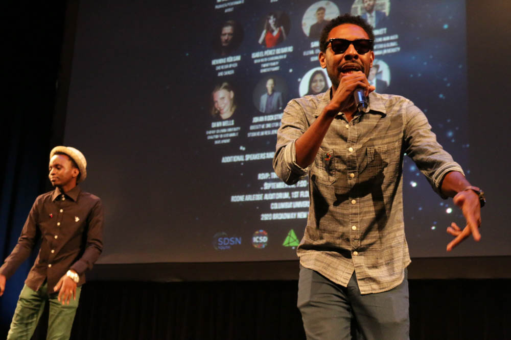 William Otuck, 27, (left) from Tanzania and Trevor Arnett, 31, (right) perform at the youth-hosted event, Reimagining 2030. Young people at the event sang, danced and rapped about the kind of future they envision after the Sustainable Development Goals are reached. (Photo by Justine Calma/GroundTruth)