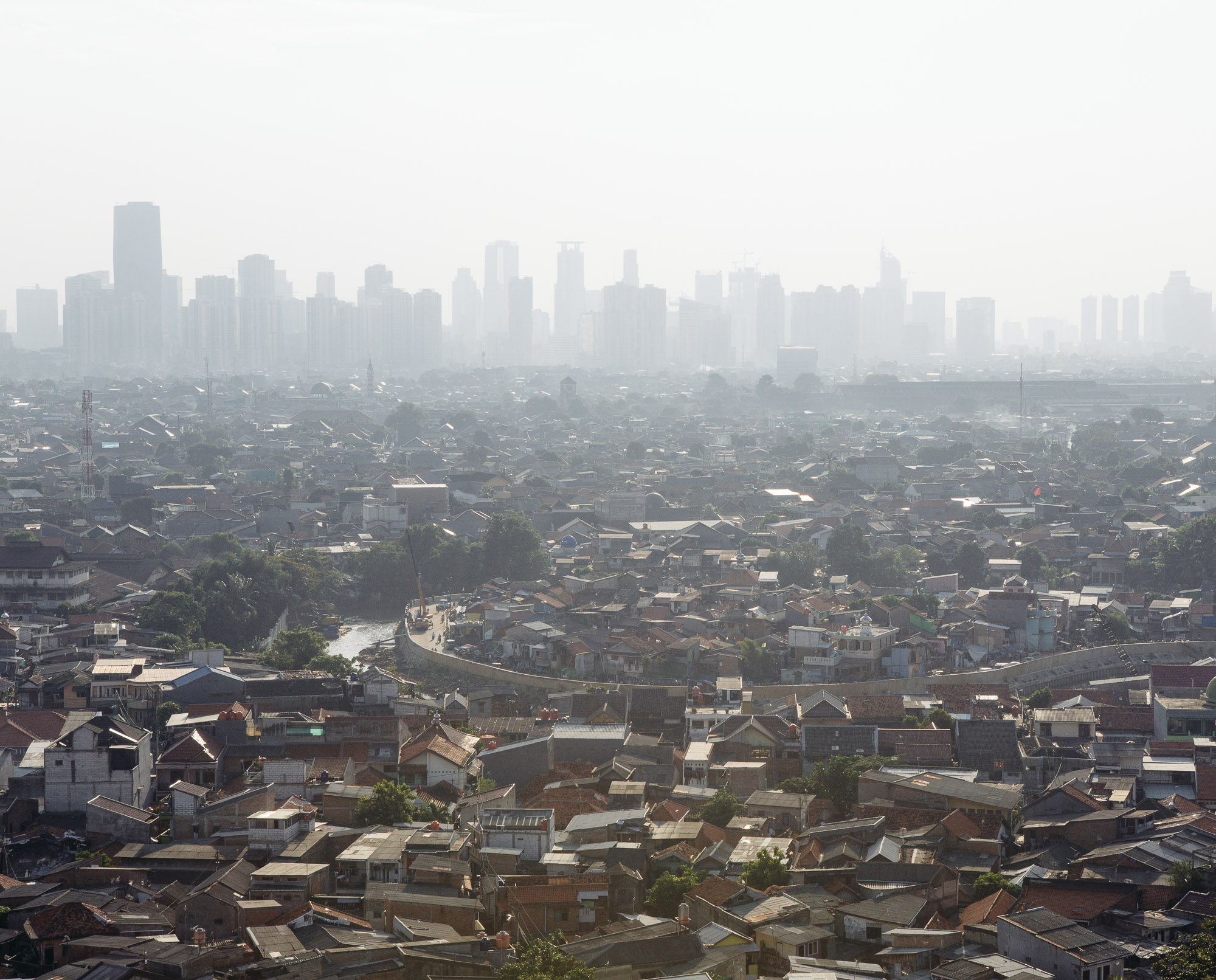The Indonesian capital of Jakarta is one of the most populated cities in the world. With over 40 percent of the city located below sea level, it is among the central battlegrounds against climate change. (Photo by Muhammad Fadli/GroundTruth)