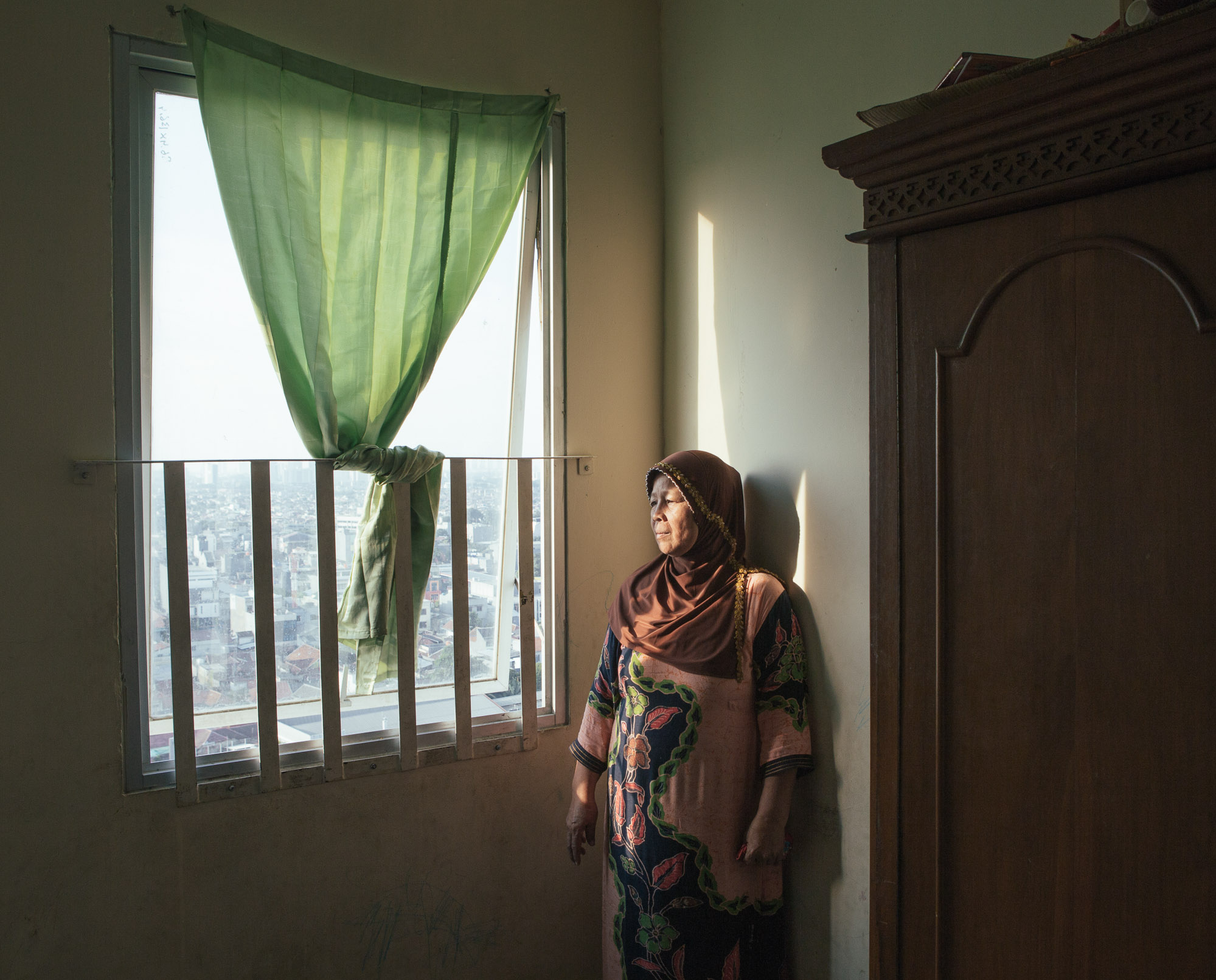 Syafitriani is among the many residents of Kampung Melayu who were evicted recently as Jakarta's government sought to revitalize the rivers to prevent flooding. She lost much of her livelihood and has to start from scratch, currently residing in a low-cost apartment nearby. (Photo by Muhammad Fadli/GroundTruth)