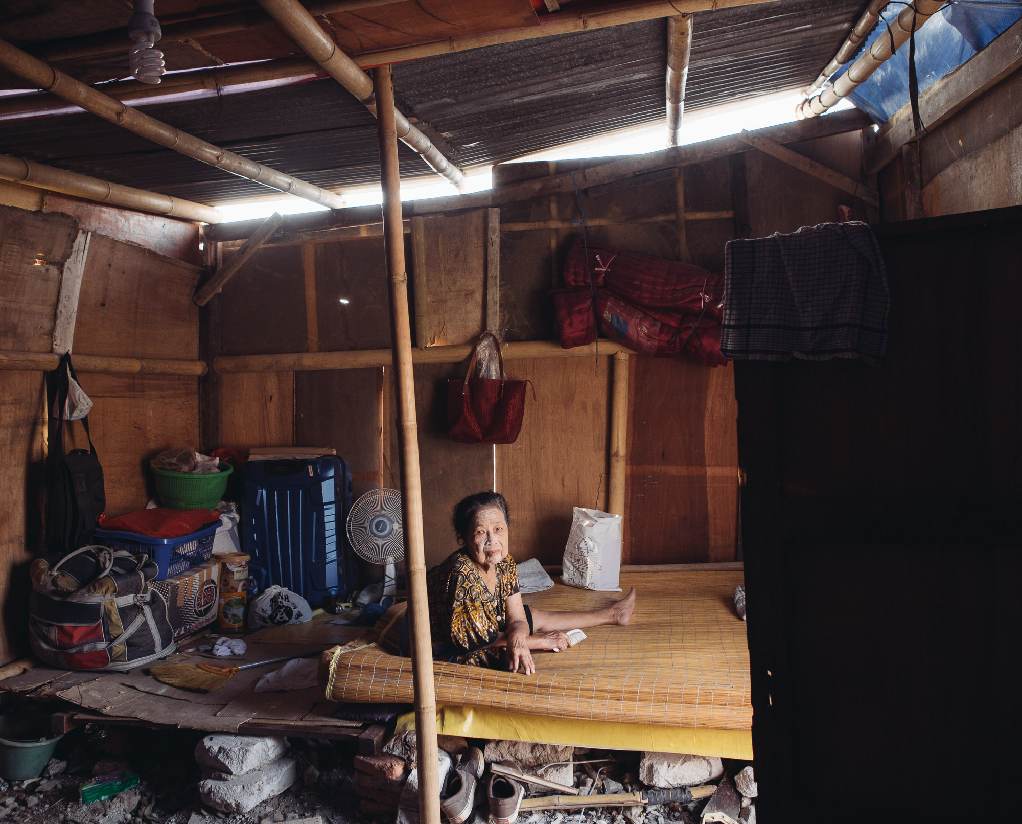 Ayuti, a resident of Pasar Ikan in North Jakarta, is among the many victims of eviction as Jakarta's government seeks to revitalize the rivers for flood prevention. Like many other Pasar Ikan residents who saw their houses destroyed, Ayuti is now living in a makeshift house built on top of rubble, and she hasn't received any compensation for her forced removal yet. (Photo by Muhammad Fadli/GroundTruth)