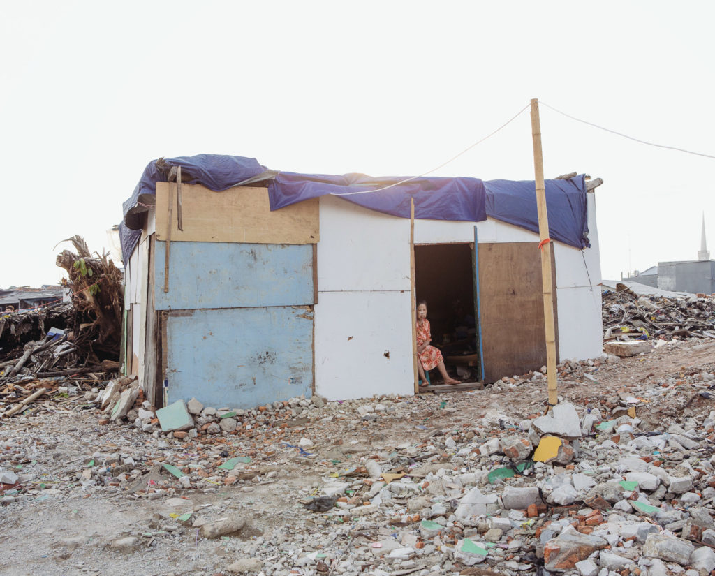 Like many other Pasar Ikan residents who saw their houses razed, Ayuti is now living in a makeshift house built on the rubble. She has yet to receive any compensation. (Photo by Muhammad Fadli)