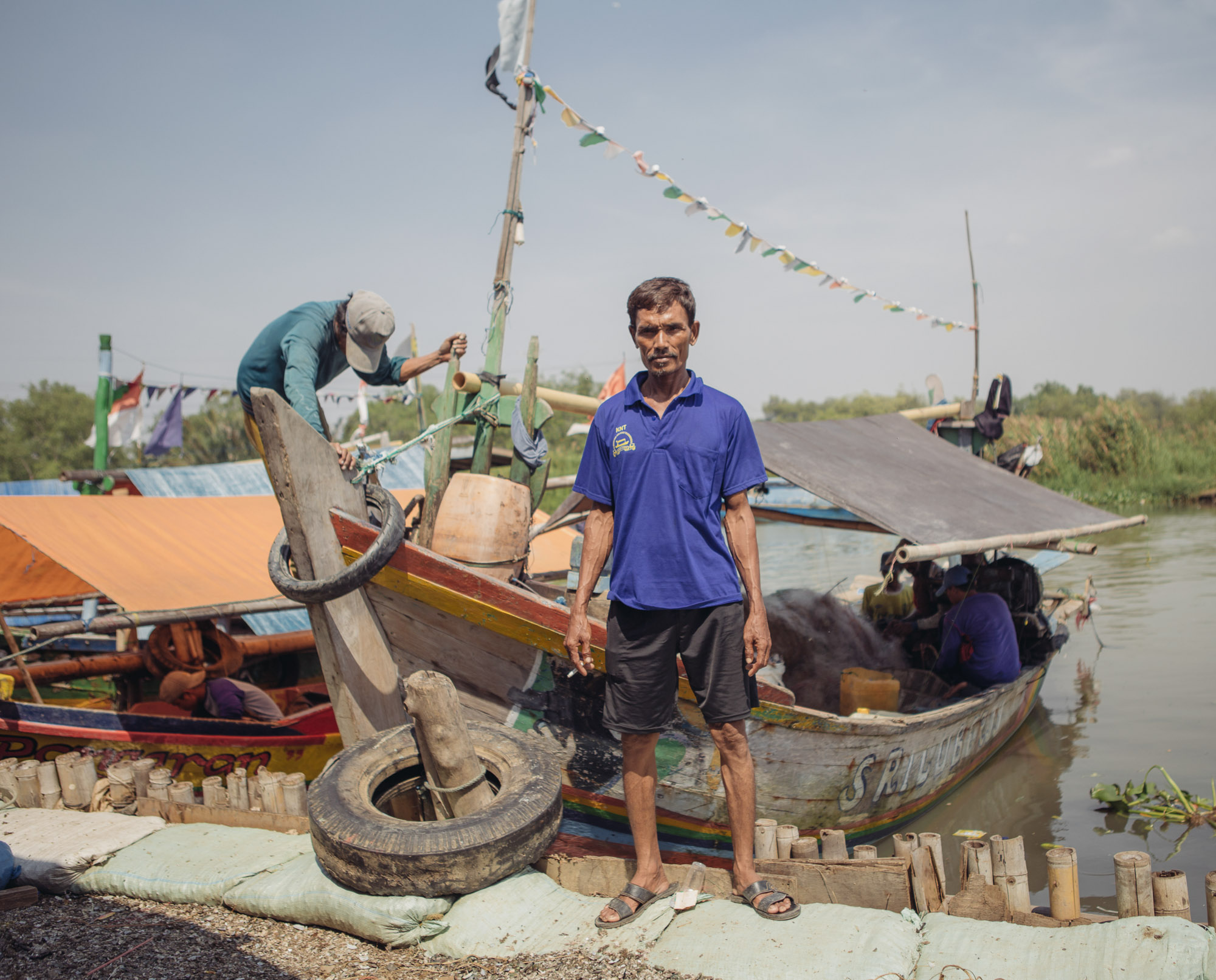 "Khalil is a fisherman living on harvested green mussels in the Jakarta bay. He is among the many opposing the Great Garuda Project, as it will affect the lives of many fishermen in the area. ""This is just so wrong"" he said. (Photo by Muhammad Fadli/GroundTruth)"