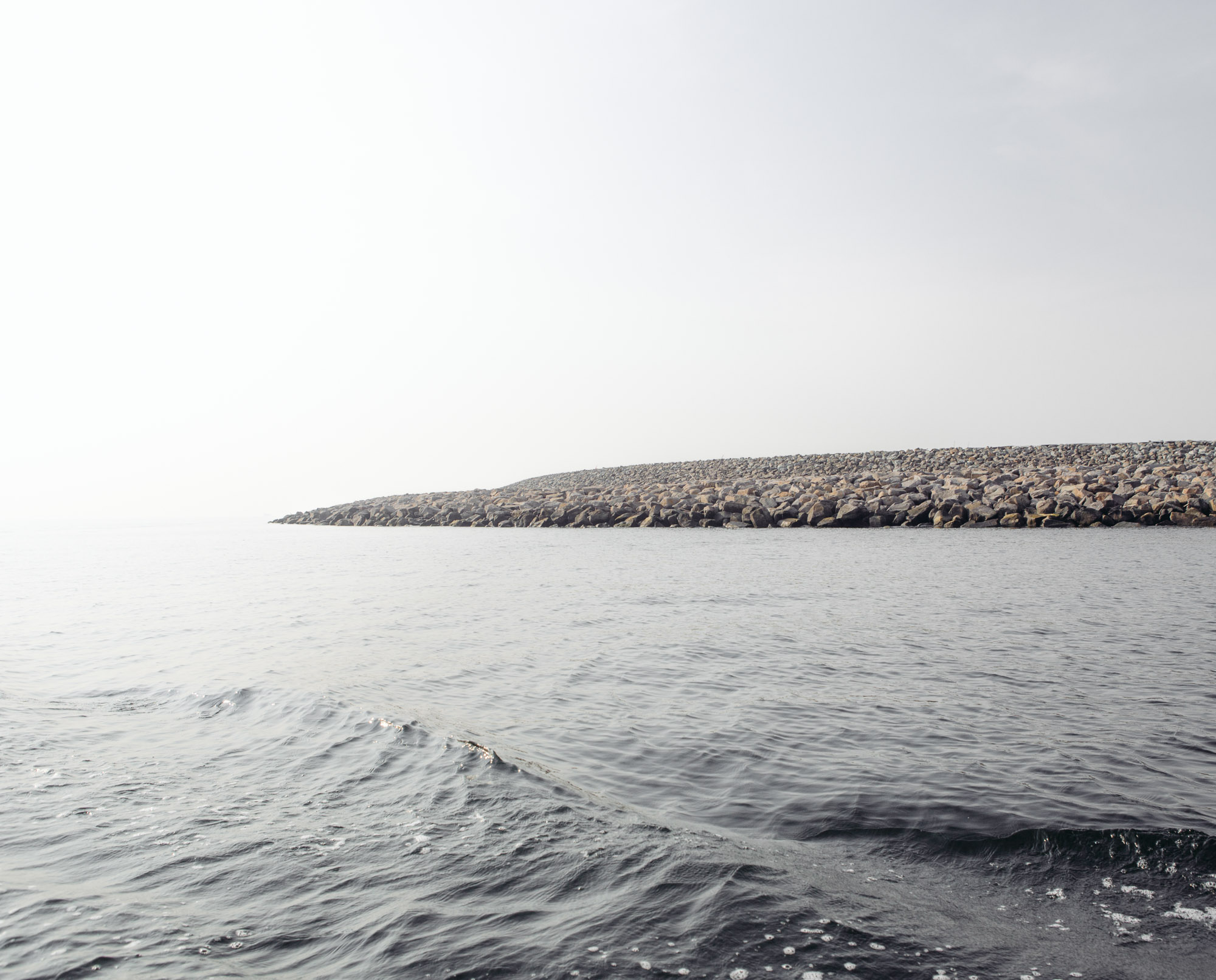 Development has already started on Island D, part of the Great Garuda project, which consist of building 17 artificial islands and a giant sea wall. Currently the work in this island is being halted for 125 days, ever since it was found to breach regulations last May. (Photo by Muhammad Fadli/GroundTruth)