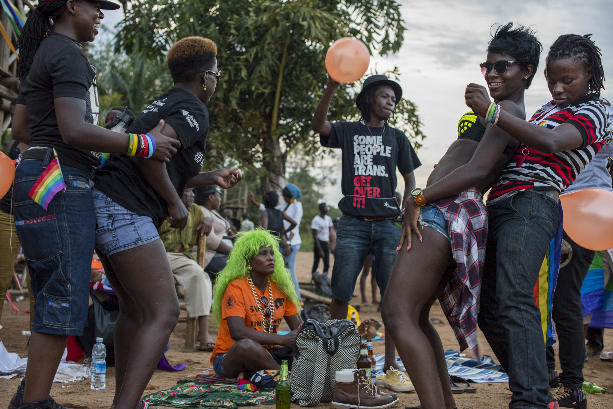 After the Pride march, members of the LGBT community and their supporters celebrate into the evening on the shores of Lake Victoria in Entebbe, 40 km from Kampala. Safety concerns made it impossible to hold the march in a more public location like downtown Kampala. (Photo by Diana Zeyneb Alhindawi/GroundTruth)