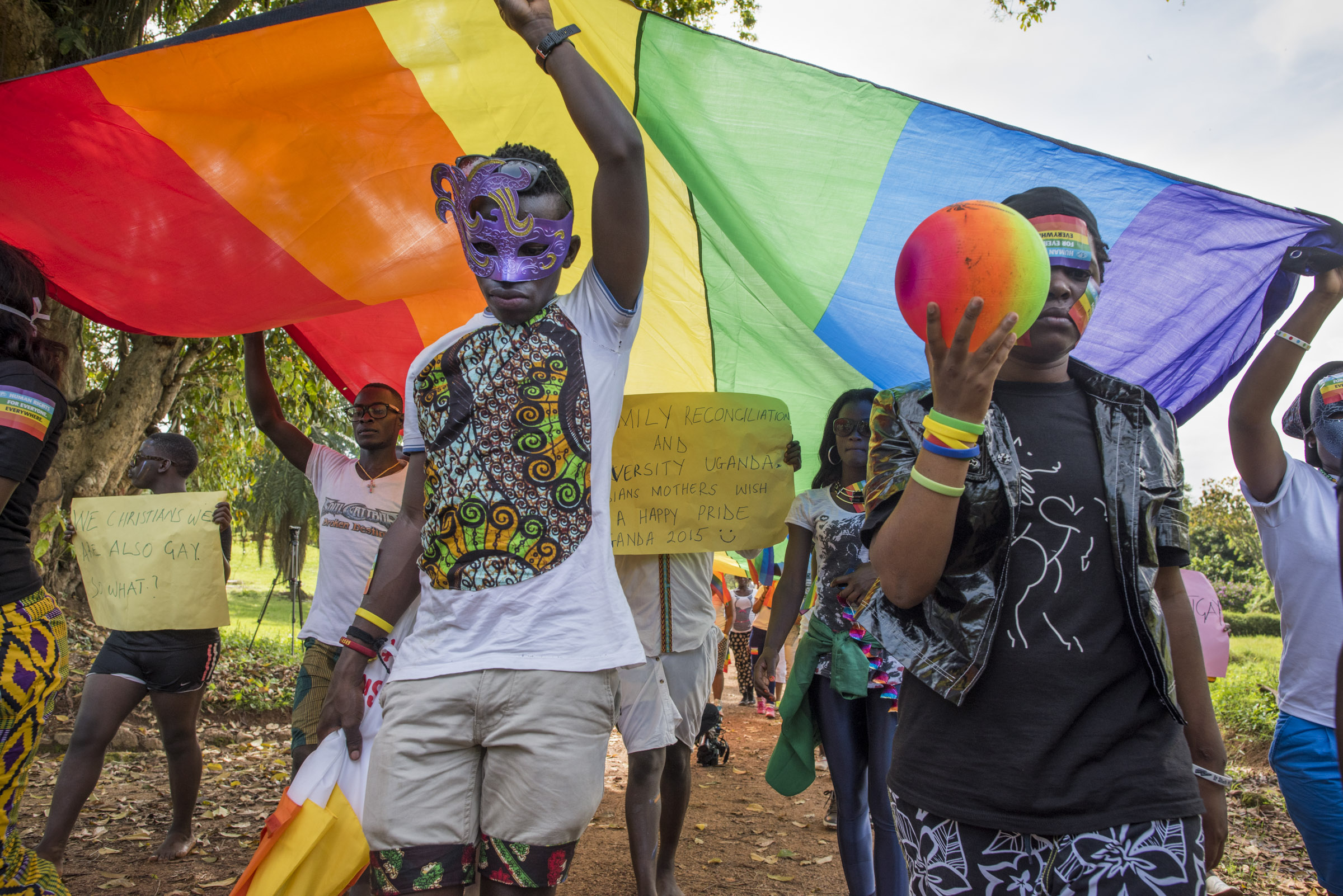 Members of the LGBT community and their supporters participate in a Pride march in a park on the banks of Lake Victoria in Entebbe, 40 km from Kampala. Safety concerns made it impossible to hod the march in a more public location like downtown Kampala. Entebbe, Uganda. August 8, 2015. (Photo by Diana Zeyneb Alhindawi/GroundTruth)