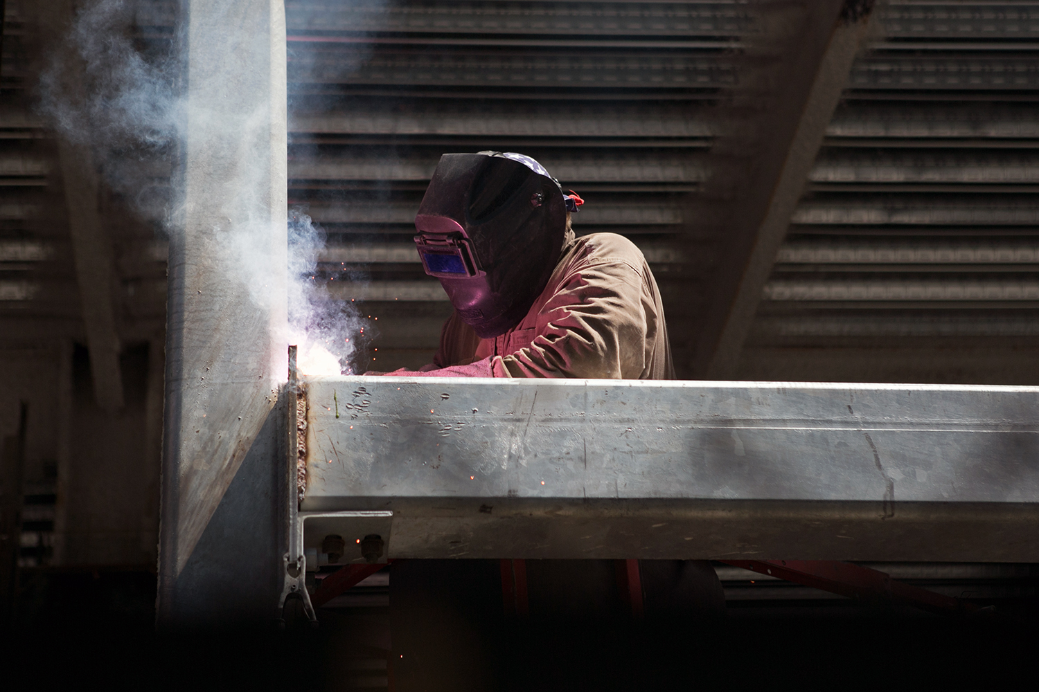 Production welder Steve Makein works on a new building in South Boston on June 6, 2016. (Photo by Lauren Owens Lambert/GroundTruth)