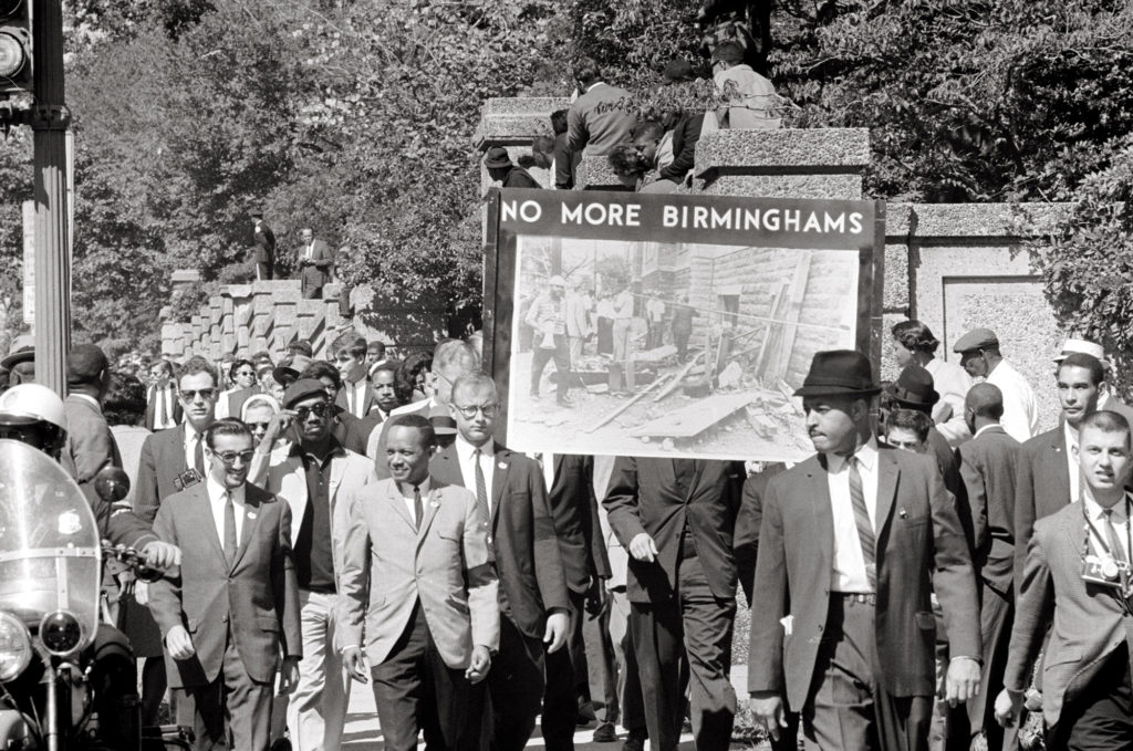 In 1963, Unitarian Universalist members of All Souls Church in Washington, D.C. march in memory of those who died in the 16th Street Baptist Church Bombing, a hate crime that killed four African American girls and injured 22 others earlier that year. (Photo by Thomas O'Halloran)