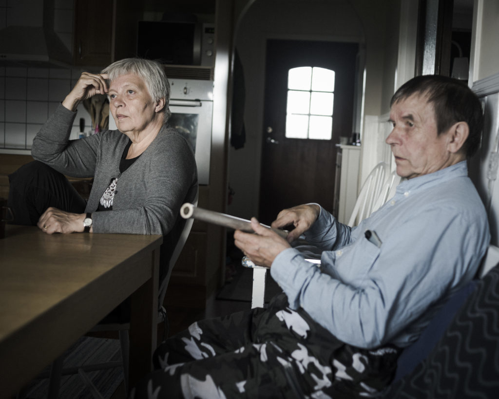 Randi and Thomas Marainen sit in their kitchen in Nedre Soppero, Sweden.