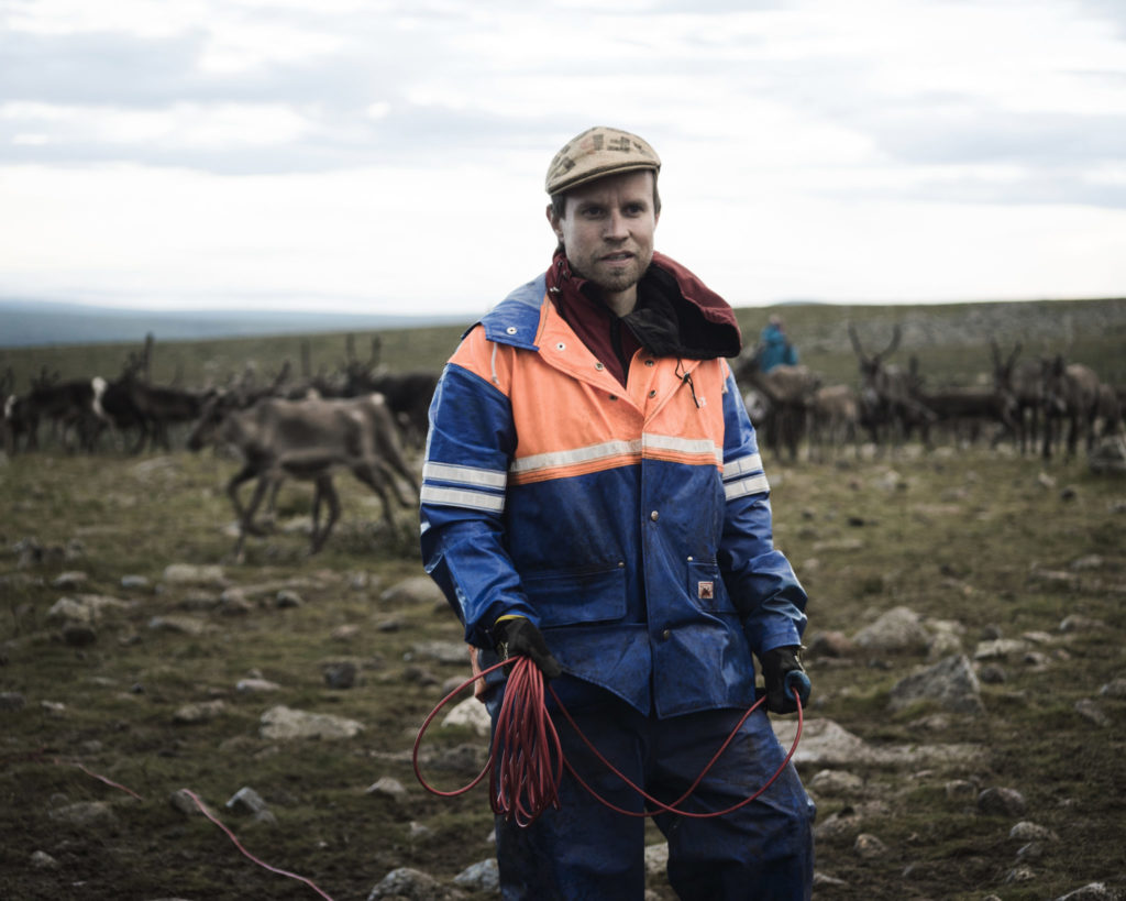 Simon Issát Marainen herds reindeer with his family outside of Nedre Soppero, Sweden. (Photo by Camilla Andersen/GroundTruth)