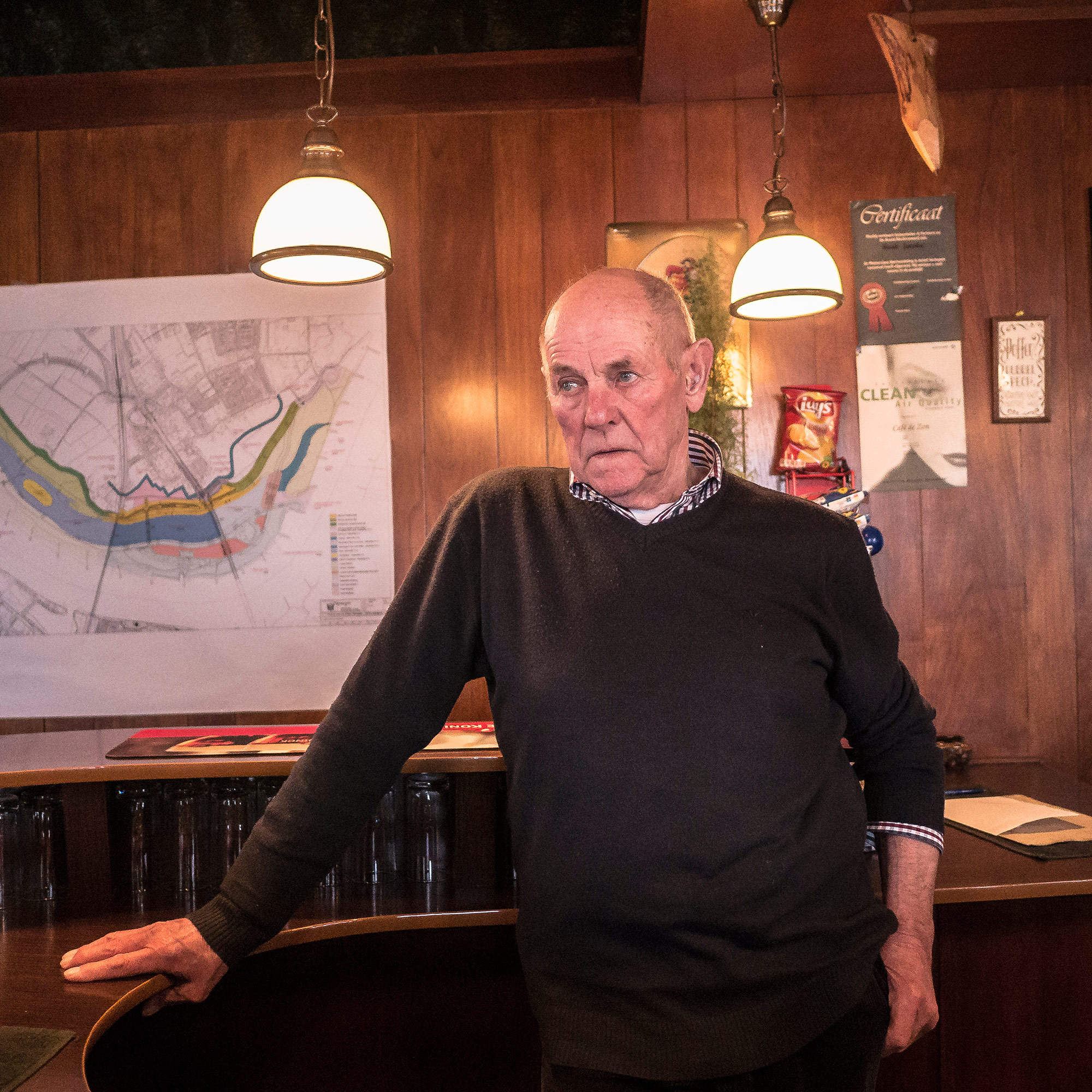 "Hendricus ""Henk"" Bernardus Jacobs is pictured inside Cafe de Zon, the bar he has run for 60 years. A new Dutch flood control project puts his cafe on an island, isolating him from the crowds he usually draws Vierdaagse. (Photo by Joris van Gennip/GroundTruth)"
