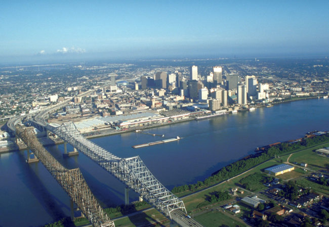 New Orleans is sinking and therefore vulnerable to flooding and storm surges.