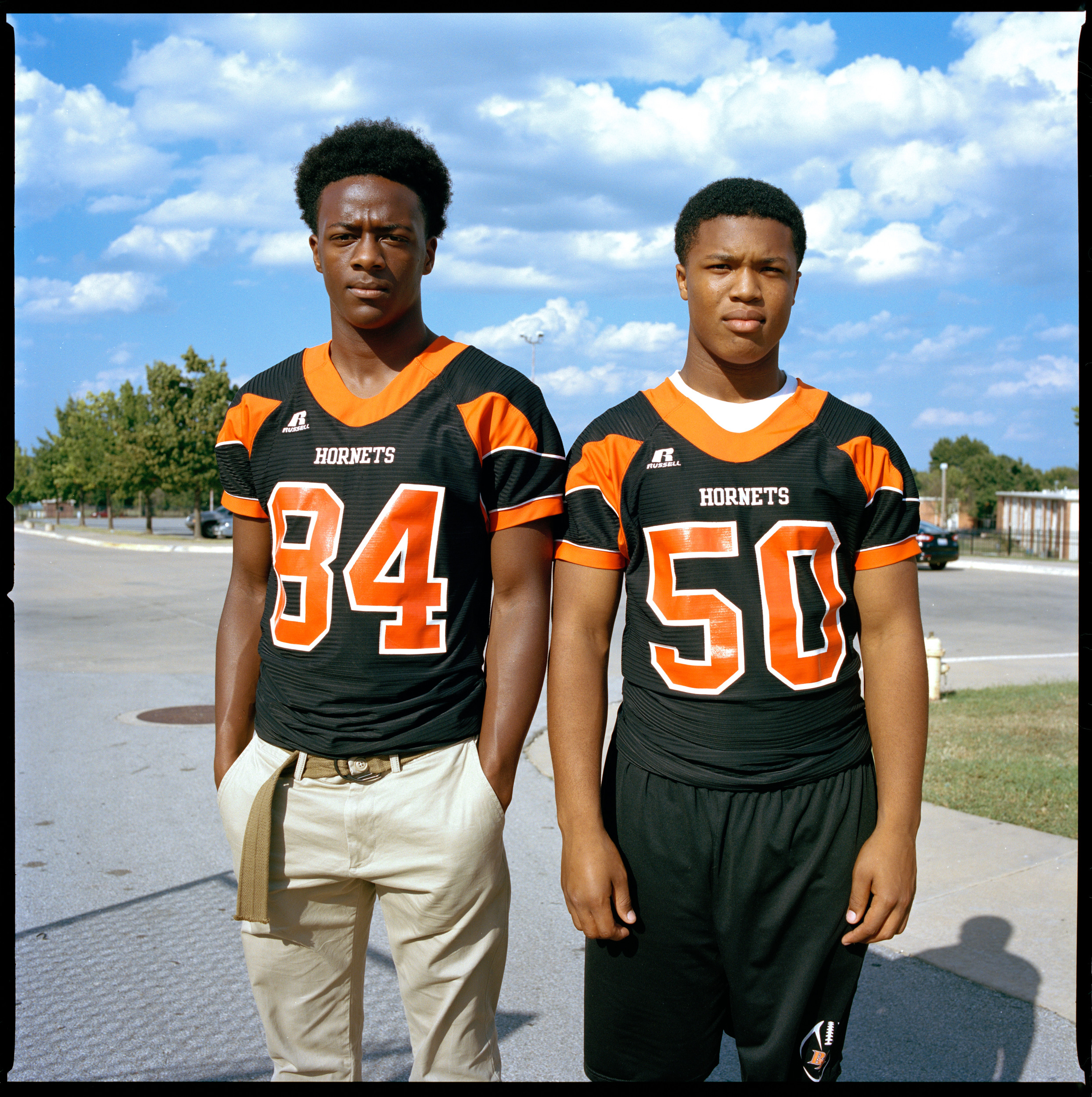 "Tulsa 5 Dwight Hamilton, 15, and Donald Broadnax, 15 before a football game at Booker T Washington High School, a historically black school. ""It feels great to know that Booker T is unified like that. It was a last minute thing for everyone to  wear black for solidarity for black lives matter. This school has a big impact and is tied into the community like that. They are are aware of what is going on. """