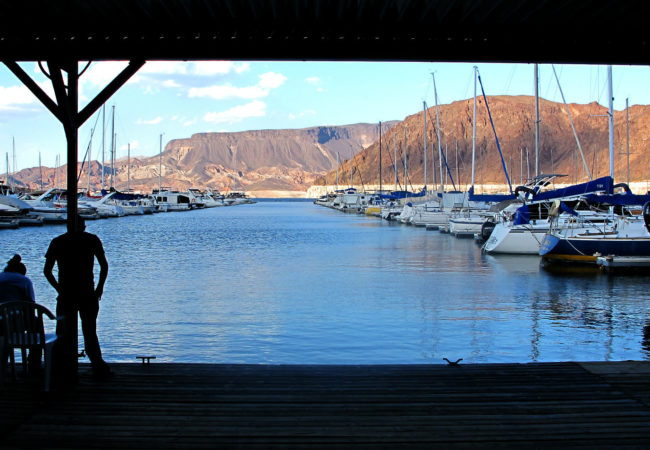 A man looks out on the Marina in Lake Mead, Nevada. (Photo by Charlotte Weiner/GroundTruth)