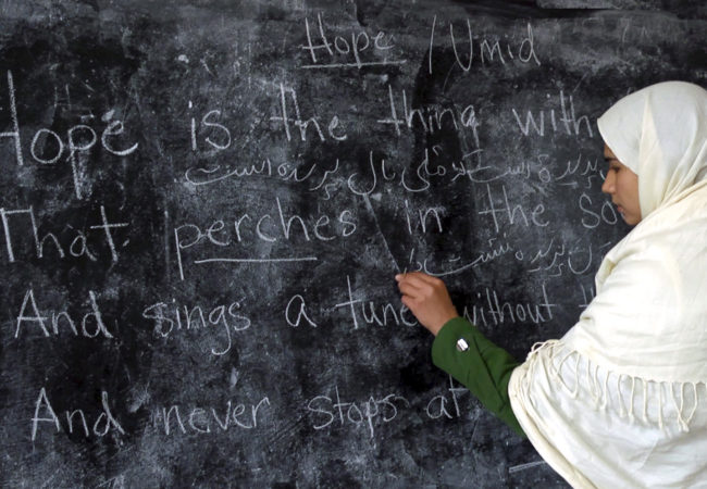 A student writes on the blackboard at the Zabuli School in Deh-Subz, Afghanistan. (Beth Murphy/GroundTruth Films)