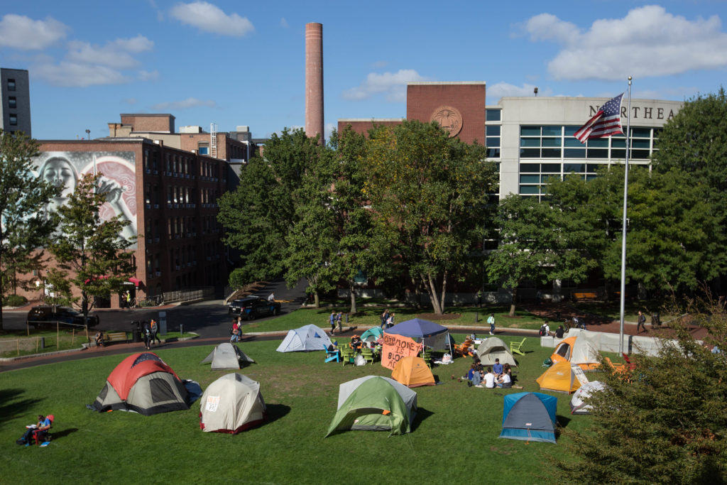 Students urged Northeastern University to divest from fossil fuels on Monday by pitching tents up on campus commons. (Photo by Alastair Pike/GroundTruth)