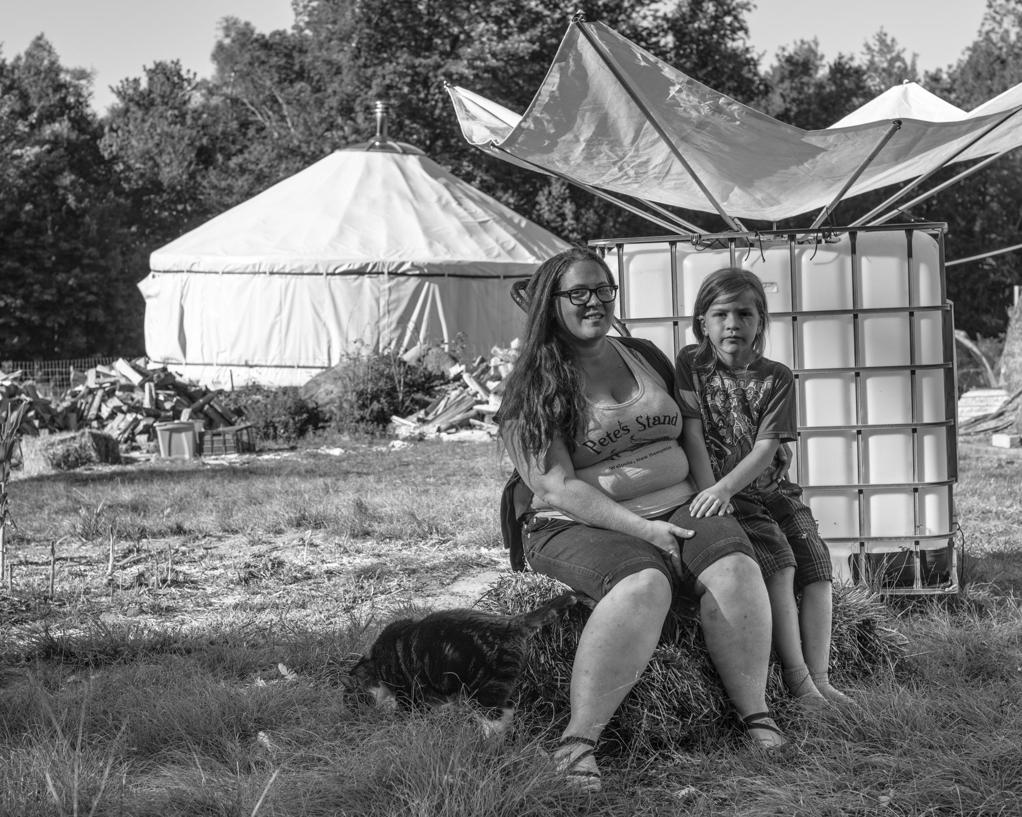Emilie Poulin and her son Octavian on their farm in Marlboro, VT.