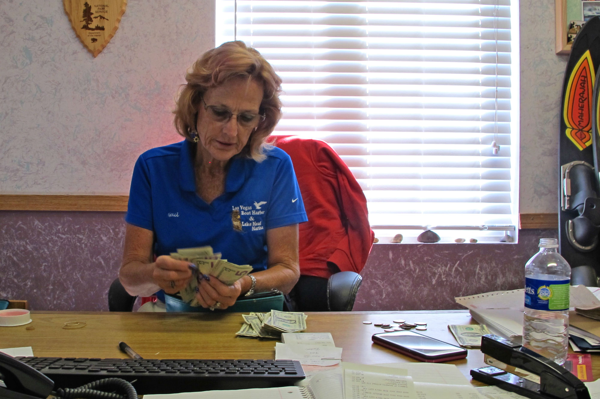 At the Grippentog's second marina, Gail Gripentog, Erin's mother, counts cash. As Mead shrinks, the Grippentogs must move their marina further inland, a process that costs approximately $100,000. In 2003, a particularly dry year, they moved the marina seven times.