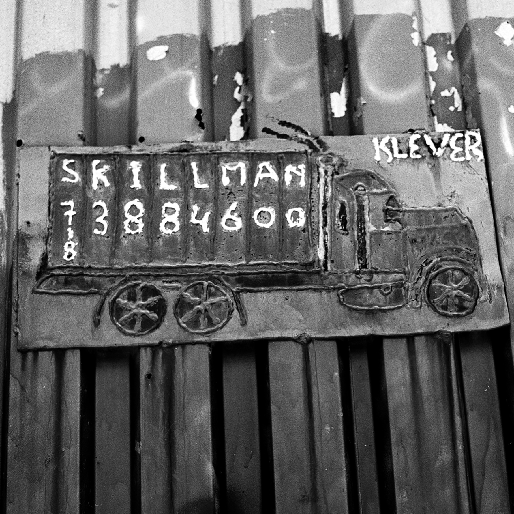 A handmade, welded sign hangs outside of Skillman Contracting on Skillman Avenue in Williamsburg, Brooklyn, New York. A makeshift memorial for Thomas R. Dolphin was put up near the intersection of Meeker Avenue and Gardner Avenue in Greenpoint, Brooklyn, N.Y. (Photo by Dakota Santiago/GroundTruth)