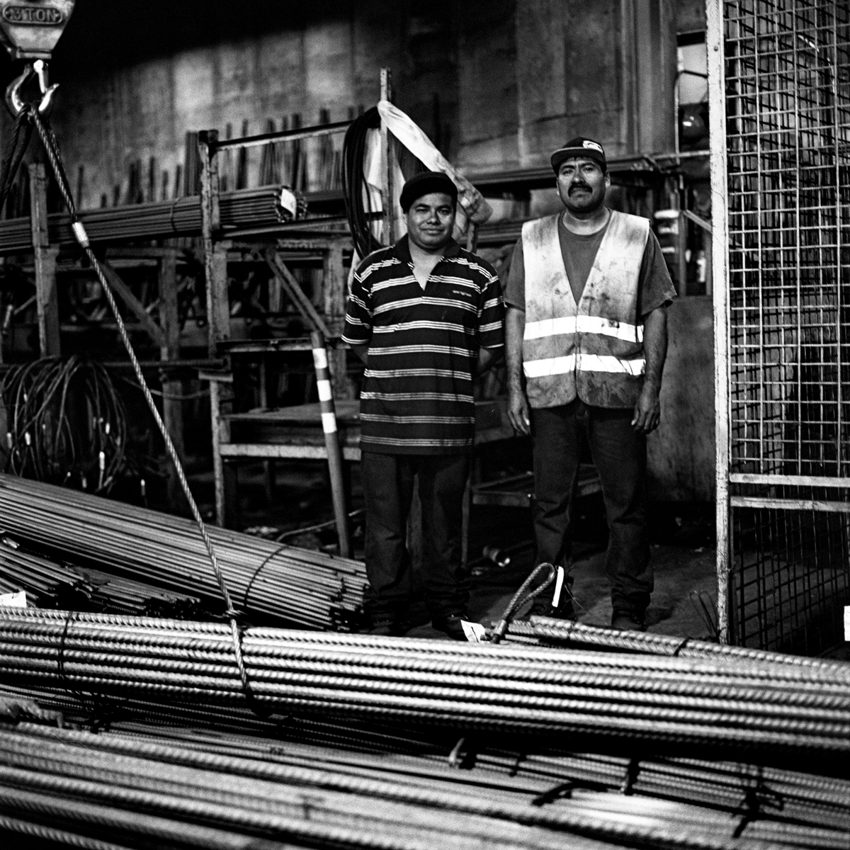 Coworkers pose inside a rebar fabrication plant, which has several thousand pounds of rebar waiting to be manipulated into different shapes and designs for a number of building projects. A makeshift memorial for Thomas R. Dolphin was put up near the intersection of Meeker Avenue and Gardner Avenue in Greenpoint, Brooklyn, N.Y. (Photo by Dakota Santiago/GroundTruth)
