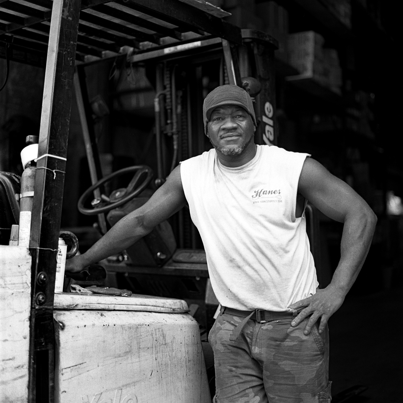 Robert, warehouse manager for Reinforcing Supply, poses beside his forklift. Previous to his position at Reinforcing Supply, Robert was a photographer for Russell Simmons' Def Jam and a printer at a photo lab in Manhattan. A makeshift memorial for Thomas R. Dolphin was put up near the intersection of Meeker Avenue and Gardner Avenue in Greenpoint, Brooklyn, N.Y. (Photo by Dakota Santiago/GroundTruth)