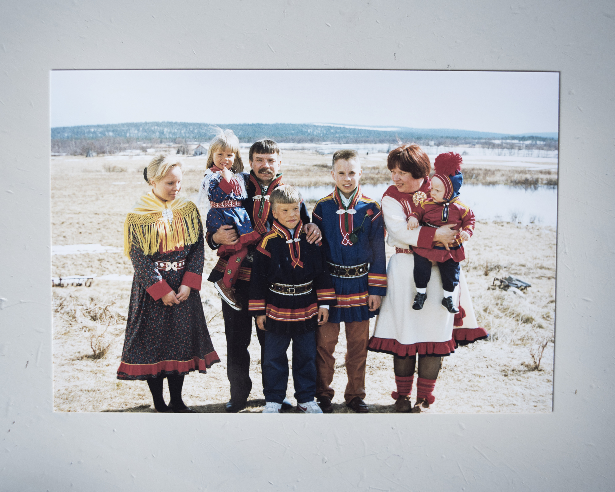 The Marainen family photographed in the early 90's. They are dressed in their traditional gáktis, on the day of Simon Issát's (third from the right) confirmation.  The family suffered great loss in 2014 when two of their boys, Gustu and Heaika, committed suicide within 10 months of each other. (Camilla Andersen/GroundTruth)