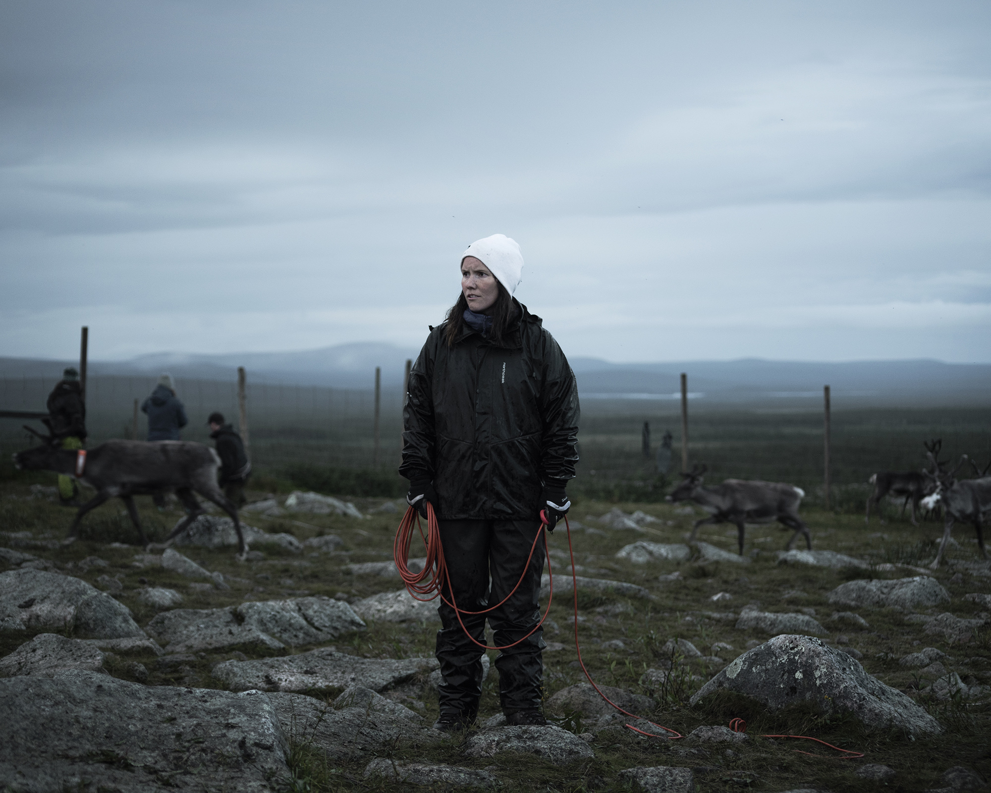 Beatrice Fløystad, inside the reindeer corral. Beatrice works to maintain the Sami language and culture, and also herds reindeer with her partner Simon Issát.  A campaign of forced assimilation, from the 1880s to 1960s, resulted in the loss of many Sami languages and dialects. (Camilla Andersen/GroundTruth)