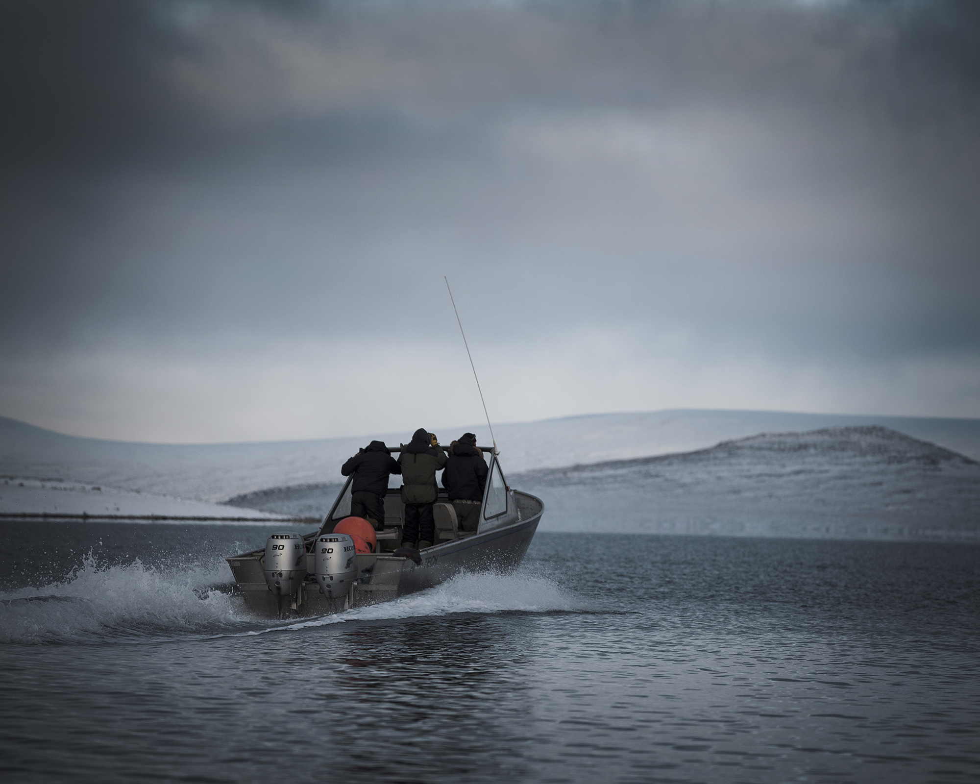 The waters surrounding Clyde River are just above freezing. Hunters go out for many hours almost every day during the fall to look for narwhals, polar bears and seals. In the 1970s, commercial seal hunting became illegal in Nunavut. Even though this ban was not directed at the Inuit, it had a huge effect on their lives. As the price of seal skin dropped, their main income from trading disappeared with it, and hunters could no longer afford fuel and ammunition to keep food on the table. (Camilla Andersen/GroundTruth)