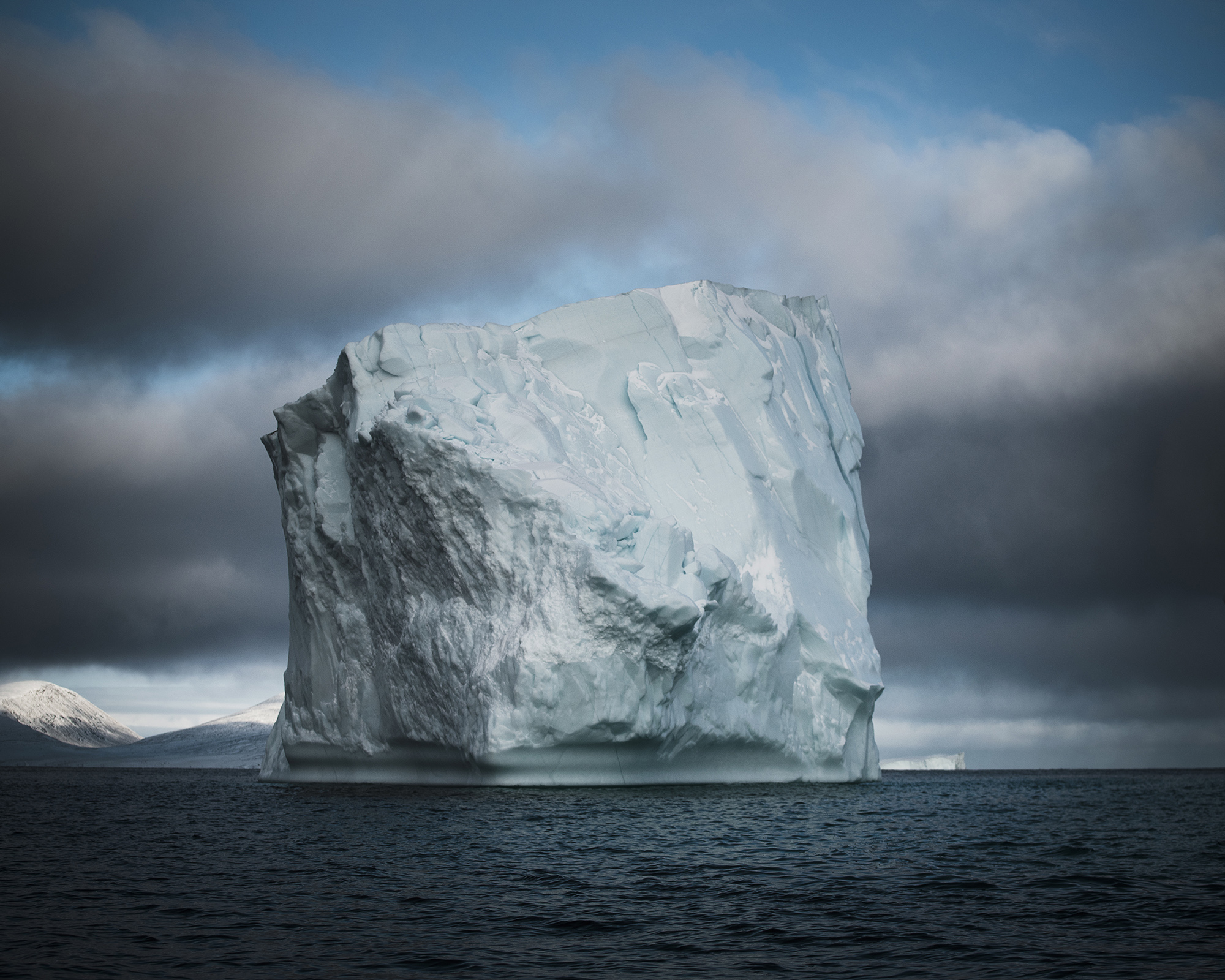 The Arctic is warming twice as fast at the rest of the world. Locals say that sea ice used to form in September in Clyde River. Now, it doesn't form until late October, or even November. The warming of the sea in the Arctic, opens up the Northwest Passage for several months a year, meaning that traffic in the area will increase, which effects marine life and Inuit hunting traditions. (Camilla Andersen/GroundTruth)