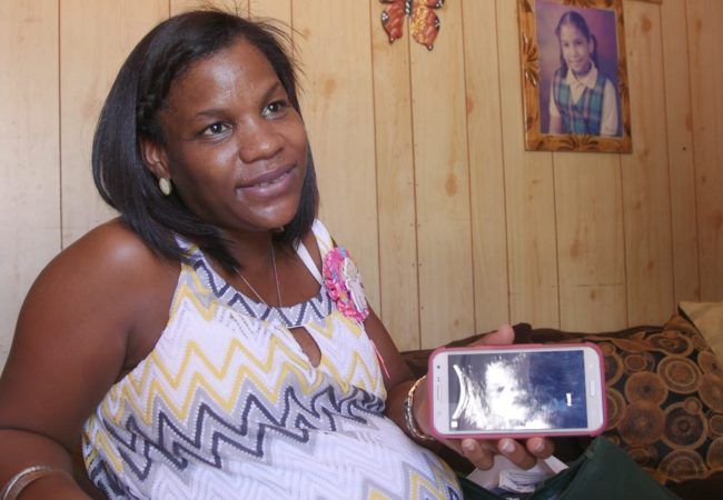 Dahiana Santana shows a sonogram of the baby she's carrying. She worries she might have contracted Zika during her pregnancy, but she never received her test results. (GroundTruth Films)