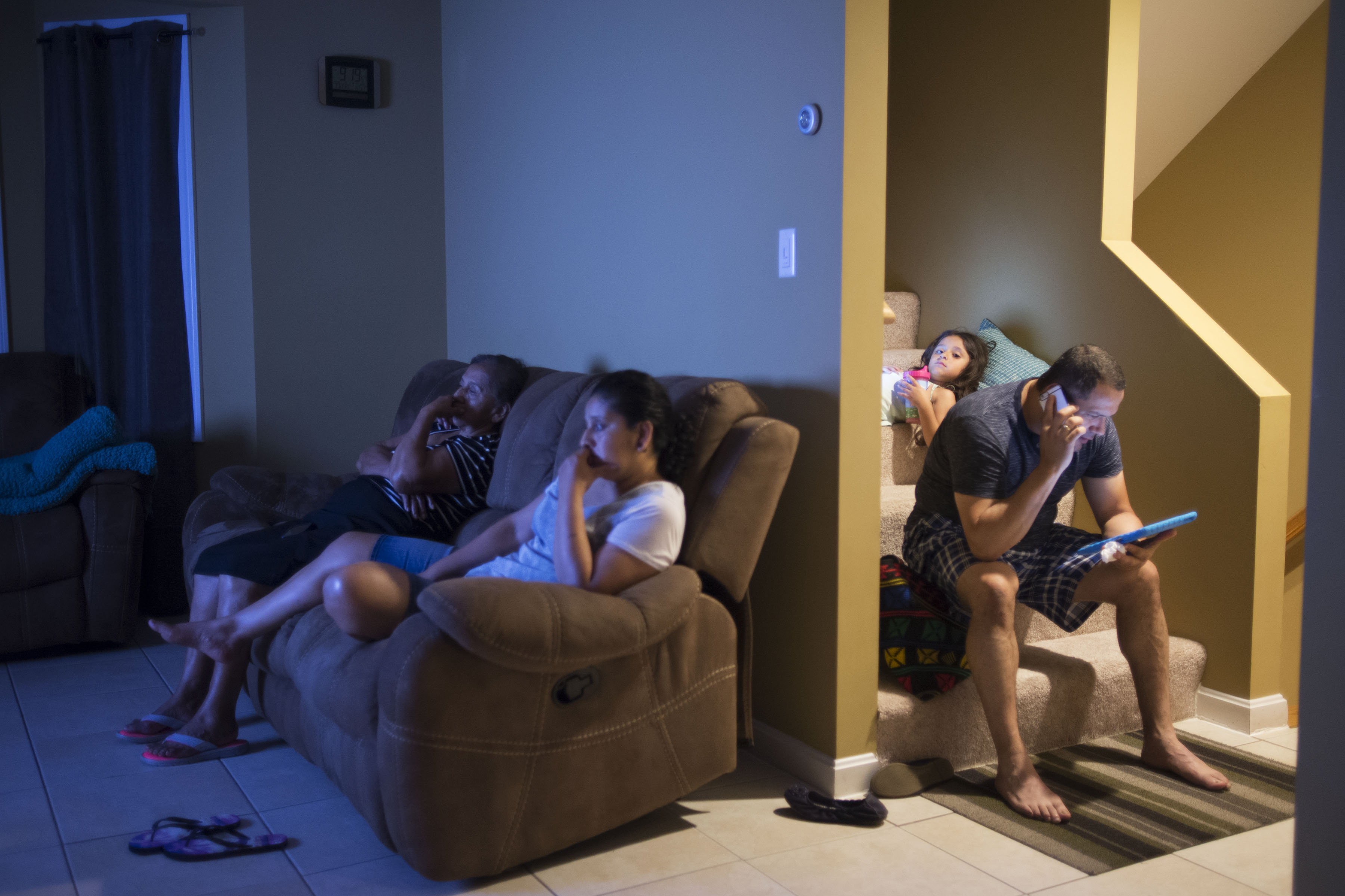 A typical evening at the Calderon household consists of my mother watching spanish soap operas and my stepfather reading on his iPad. My grandmother (far left) visits from Guatemala. We live 30 mins outside of Boston, in Lawrence, Massachusetts. We have been here for over 7 years. This is our first family-owned house in the United States. (Photo by Iaritza Menjivar/GroundTruth)