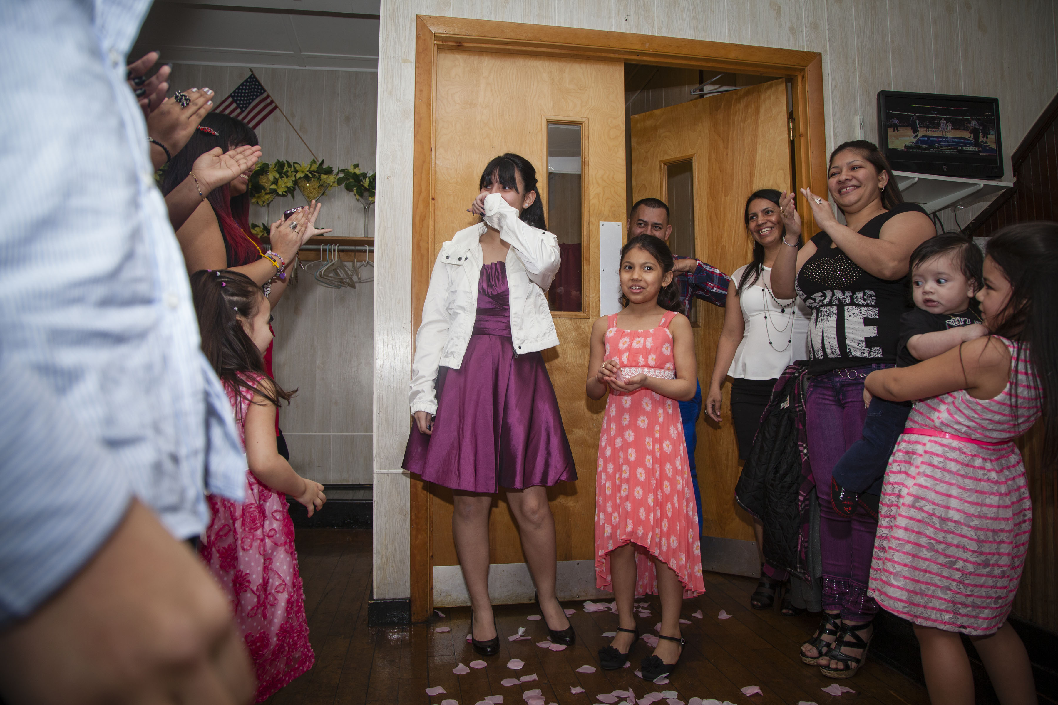 """A friend of the family, Sandy Maldonado, celebrates her 14th birthday. In this countr,y we can have a big celebration at 14 just because we want to, but the real birthday party is supposed to be at 15 for whats called a """"quinceanera,"""" the year that marks a girl's passage to womanhood. I remember when my mom once told me that, for her quinceanera, her mom pulled all of her savings to just afford a dress at the local street market. (Photo by Iaritza Menjivar/GroundTruth)"""